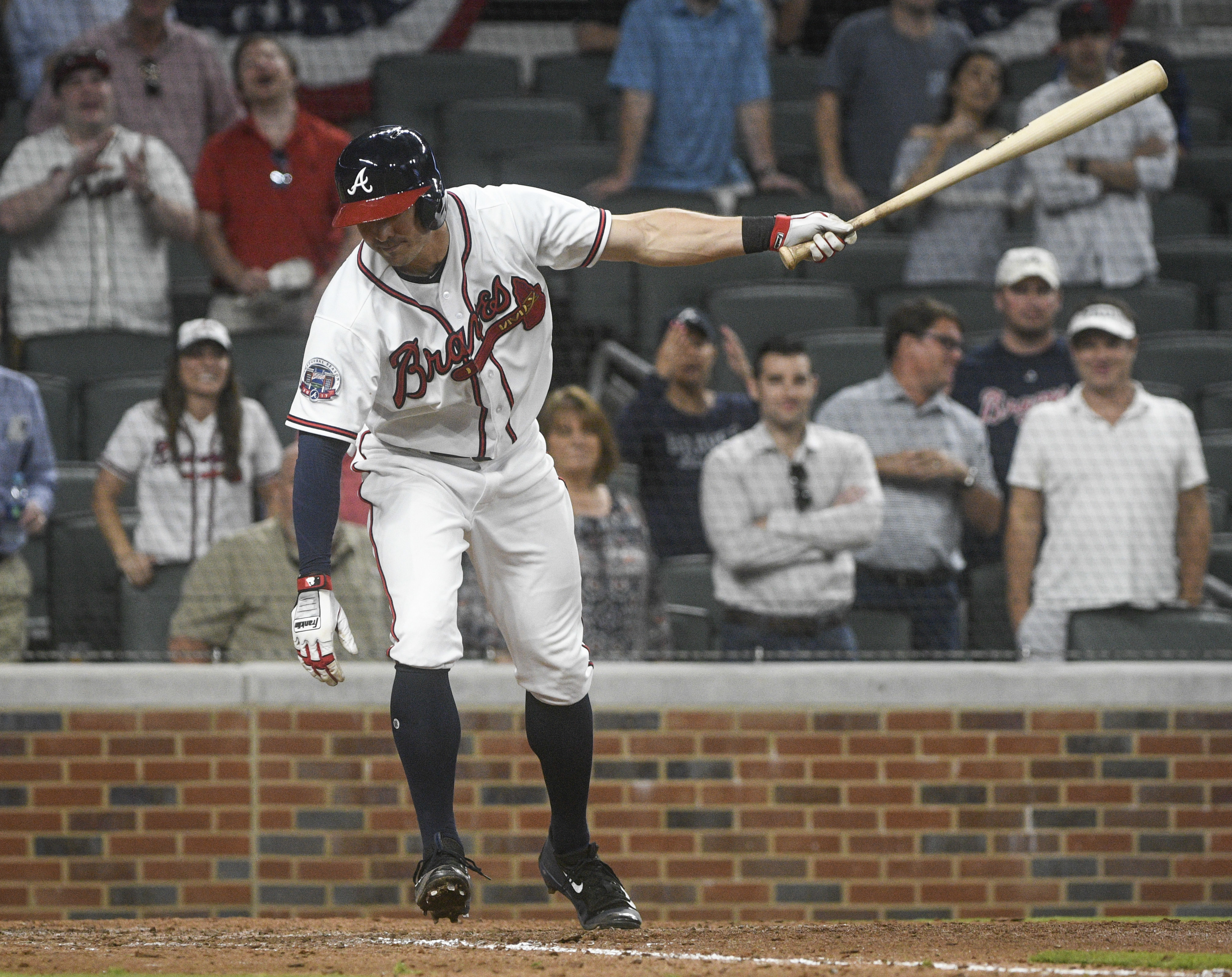 Atlanta Braves' Chase d'Arnaud strikes out with bases loaded to end a baseball game against the Washington Nationals, Tuesday, April 18, 2017, in Atlanta. Washington won 3-1. (AP Photo/John Amis)