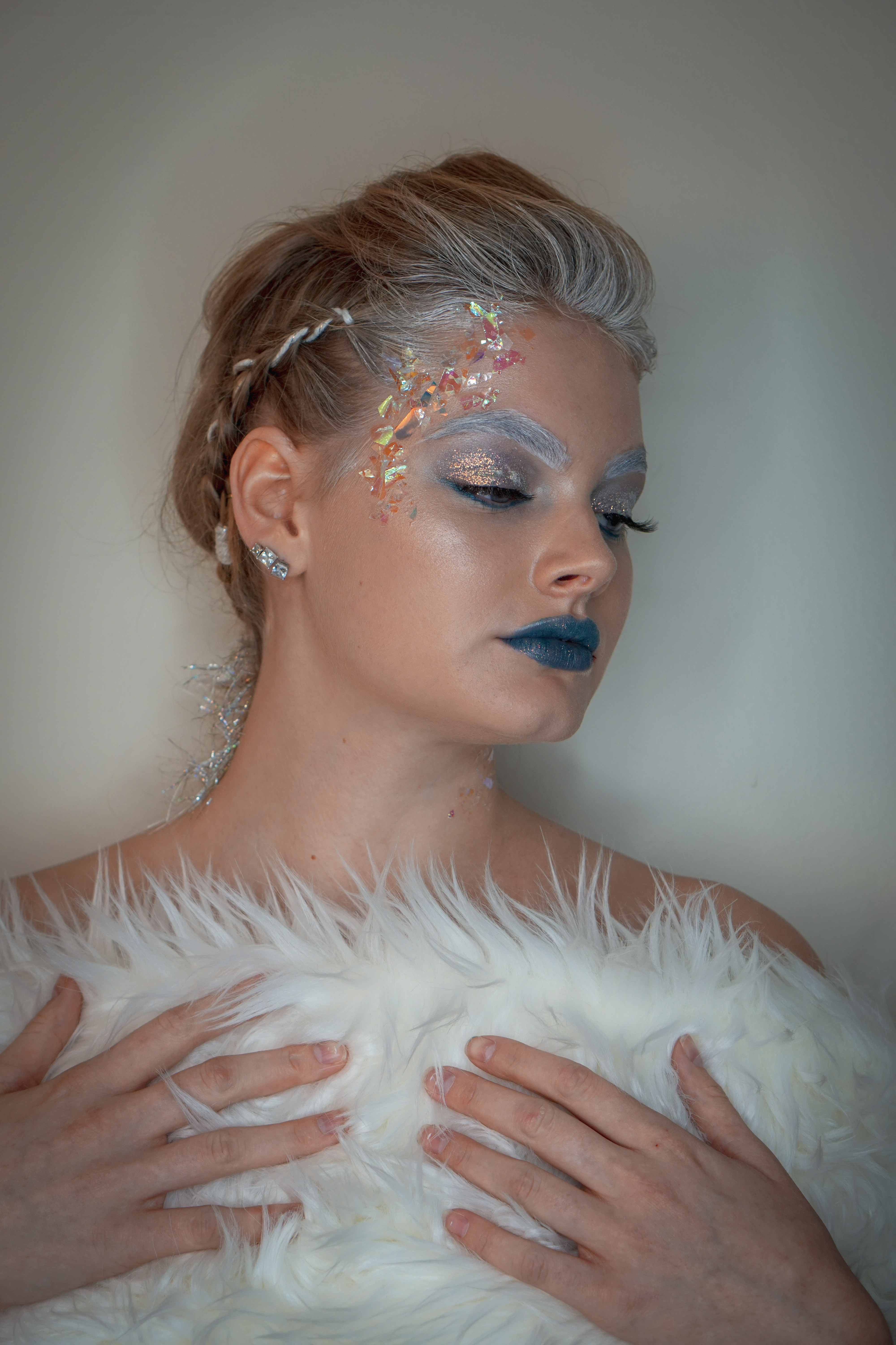 Ice Princess by JoAnn from The Style Witch: Step 1. Blow out all hair with a medium sized round brush. Step 2. Create 3 sections. Braid side sections. Tease mohawk section, fan out, and use a small rubber band to secure. Step 3. Use icy yard and cord to adorn the hair (Image courtesy of Style Witch).