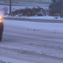 Snow heading east, but roads still slick