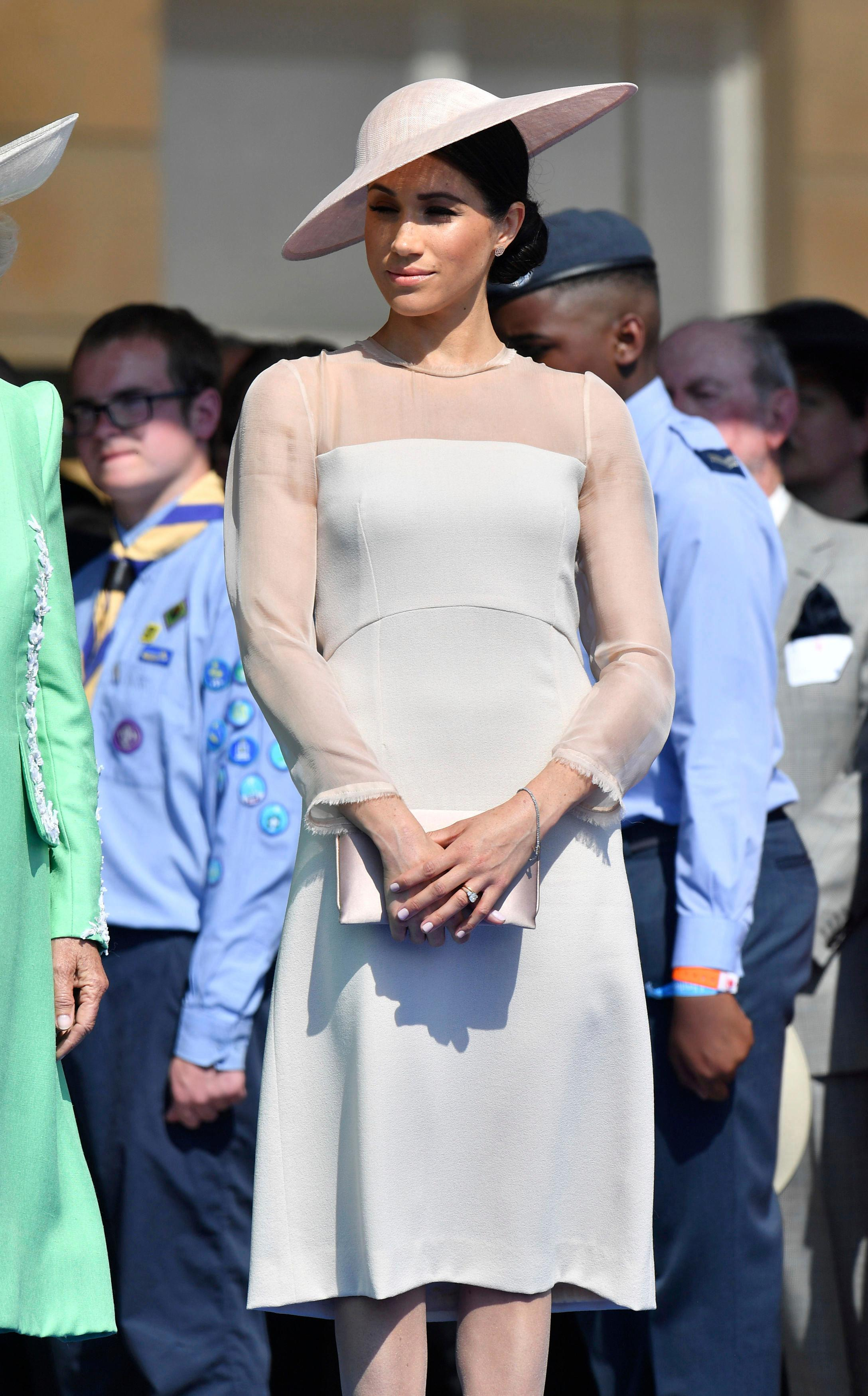 Meghan, the Duchess of Sussex attends a garden party at Buckingham Palace in London, Tuesday May 22, 2018, her first royal engagement since her wedding to Prince Harry on Saturday. The event is part of the celebrations to mark the 70th birthday of Prince Charles.  (Dominic Lipinski/Pool Photo via AP)