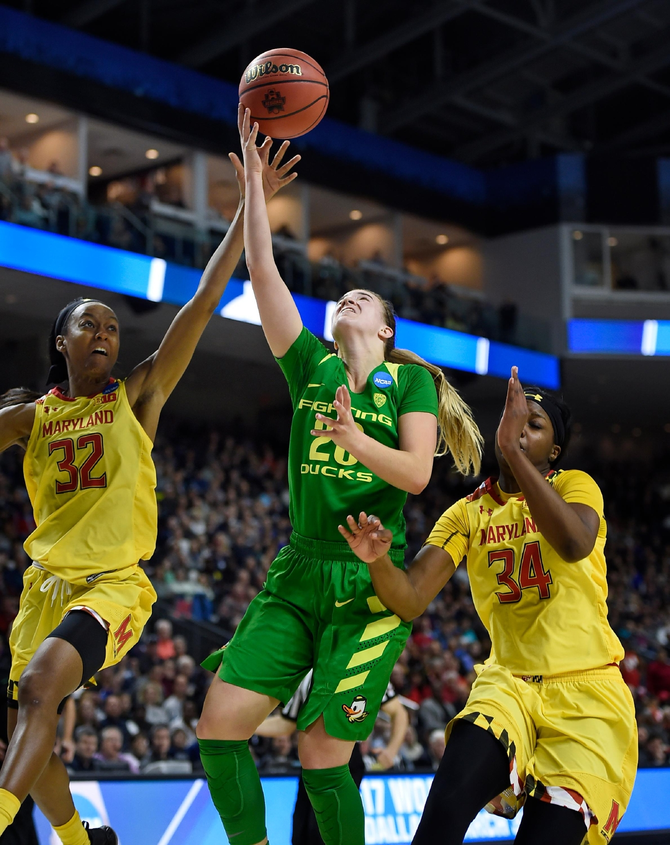 Oregon's Sabrina Ionescu shoots between Maryland's Shatori Walker-Kimbrough, left, and Maryland's Brianna Fraser, right, during the second half of a regional semifinal game in the NCAA women's college basketball tournament, Saturday, March 25, 2017, in Bridgeport, Conn. (AP Photo/Jessica Hill)