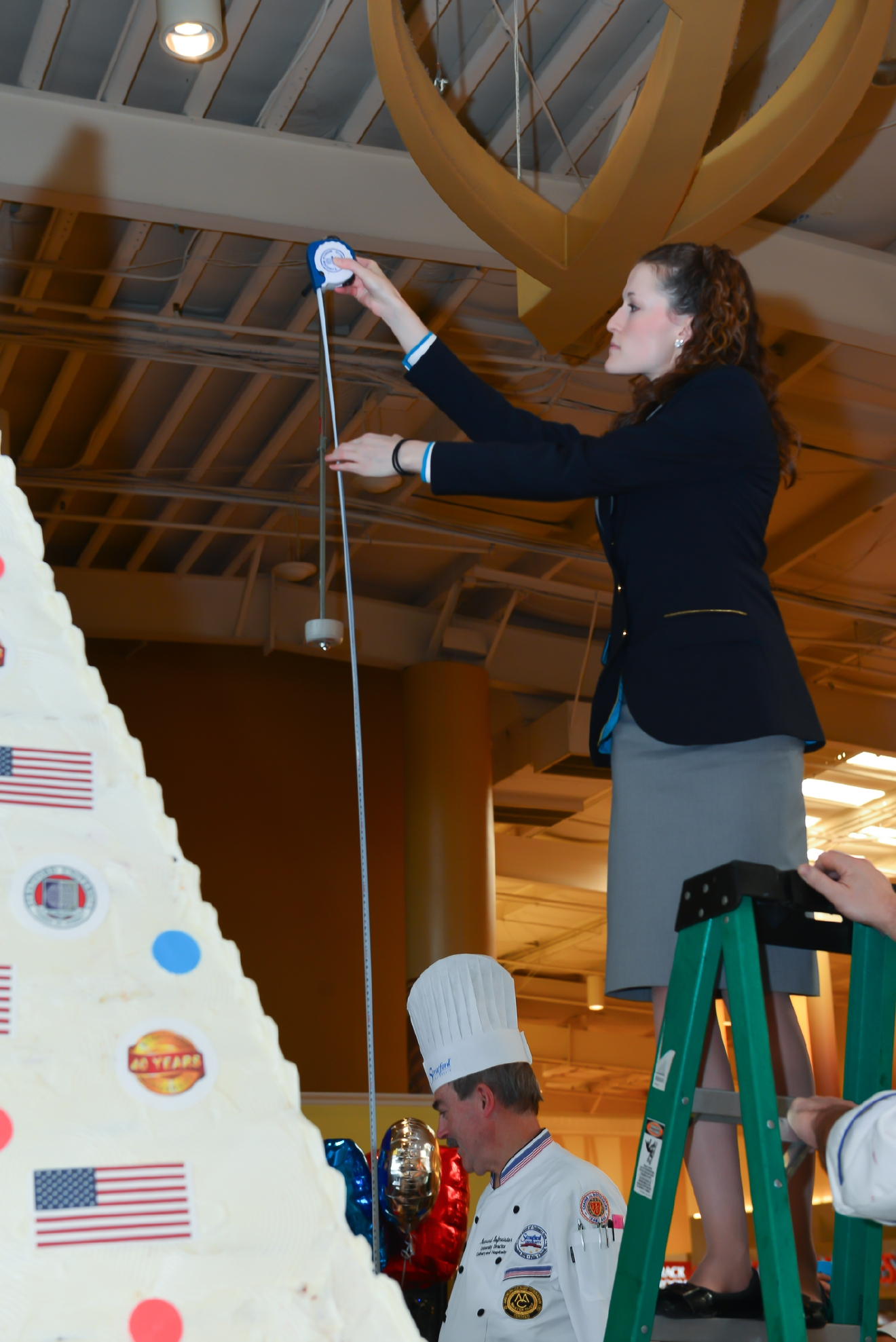 Guinness World Records Judge Kellie Ferrick takes the essential measurement to determine the new world record. (Image: Courtesy Stratford University)