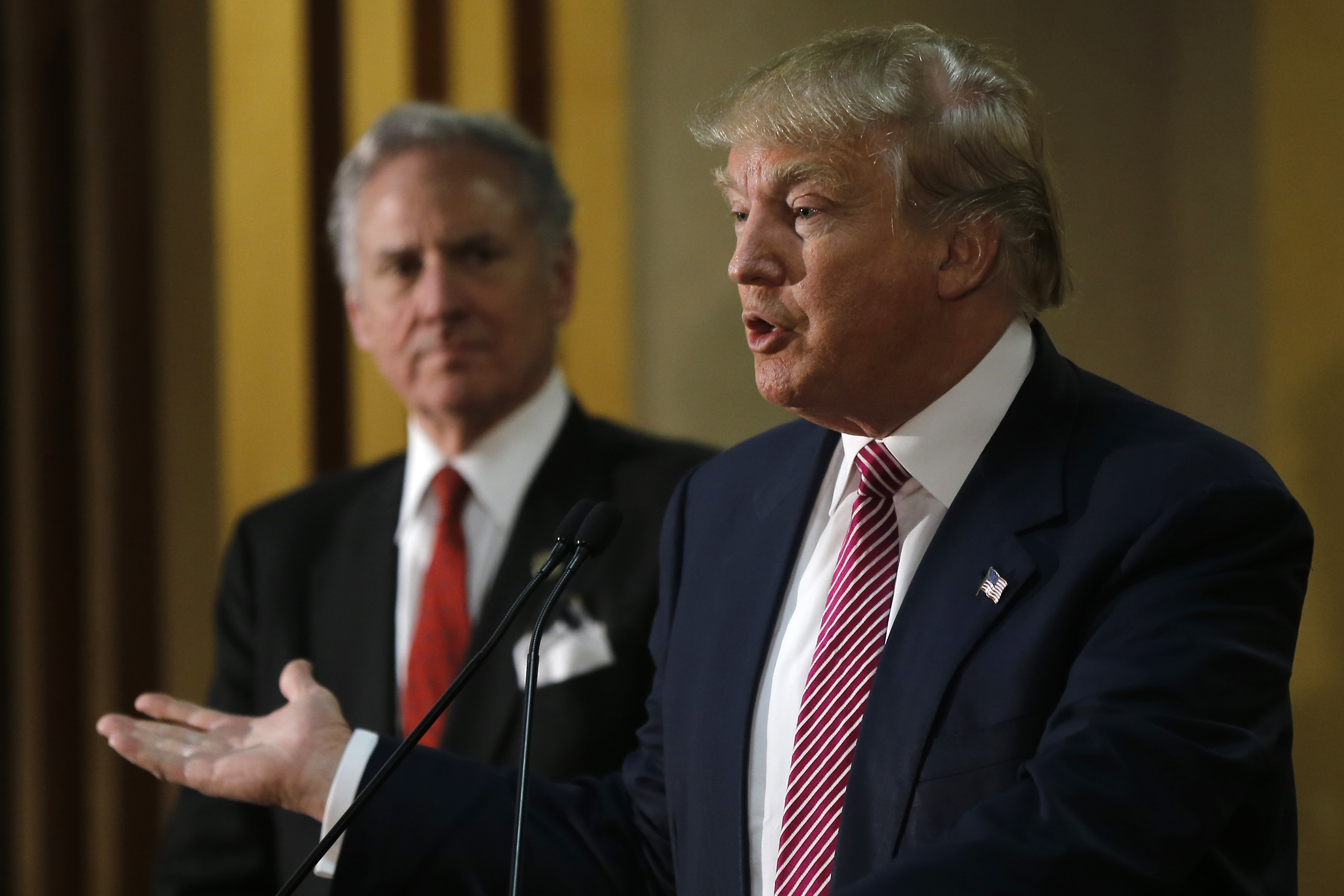 Republican presidential candidate Donald Trump, right, accompanied by South Carolina Lt. Gov. Henry McMaster, speaks with members of the media during a news conference Monday, Feb. 15, 2016, in Hanahan, S.C. (AP Photo/Matt Rourke)