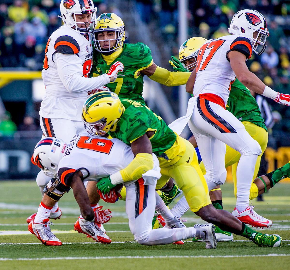 Oregon Ducks defense tackles Oregon State Beavers Victor Bolden (#6)  in the Civil War game in Autzen Stadium. At the half the Ducks led the Beavers 31 - 7. Photo by Katie Pietzold, Oregon News Lab