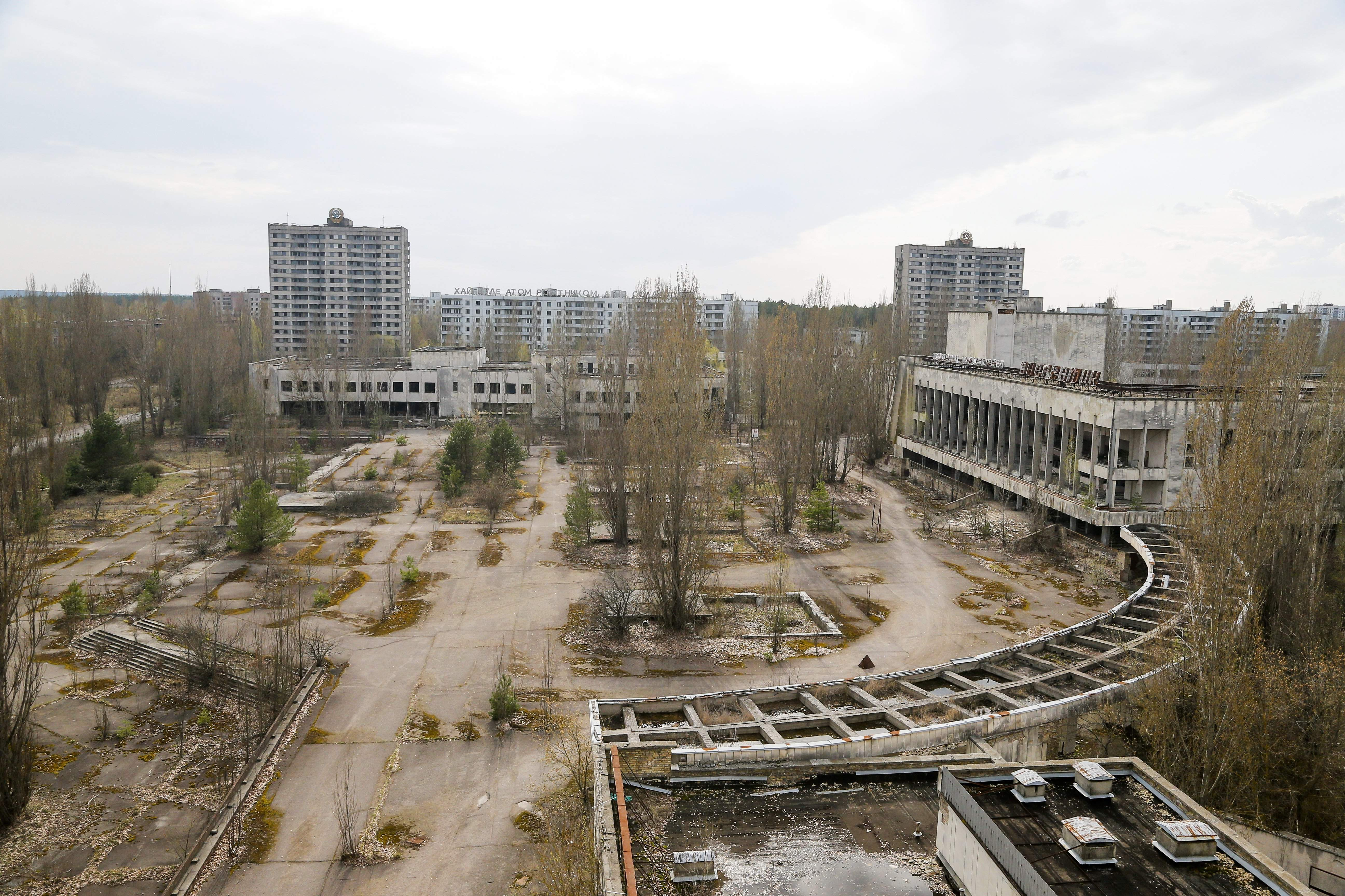 This photo taken Wednesday, April 5, 2017, shows a central square in the deserted town of Pripyat, some 3 kilometers (1.86 miles) from the Chernobyl nuclear power plant Ukraine. Once home to some 50,000 people whose lives were connected to the Chernobyl nuclear power plant, Pripyat was hastily evacuated one day after a reactor at the plant 3 kilometers (2 miles away) exploded on April 26, 1986. The explosion and the subsequent fire spewed a radioactive plume over much of northern Europe. THE ASSOCIATED PRESS