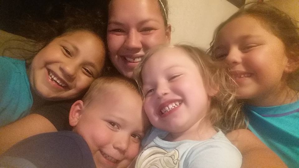 Joann Ward, 30, seen in the back with her children: daughter Emily (8) far left, son Ryland (5), daughter Brooke (5), and daughter Rihanna (9) far right. Joann, Emily, and Brooke were killed. Ryland was shot but survived. Rihanna was not hurt. (Courtesy photo)<p></p>