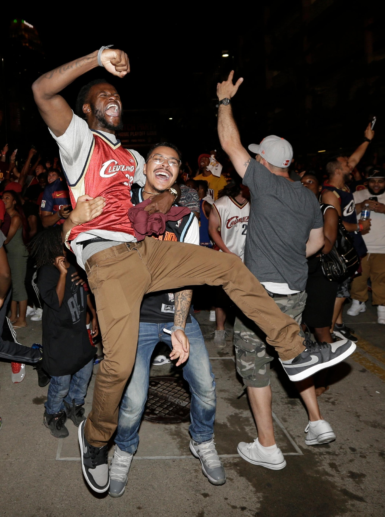 Cleveland Cavalier fans celebrate after the Cavaliers defeated the Golden State Warriors, 93-89, in Game 7 of the NBA basketball Finals, Sunday, June 19, 2016, in Cleveland. (AP Photo/Tony Dejak)