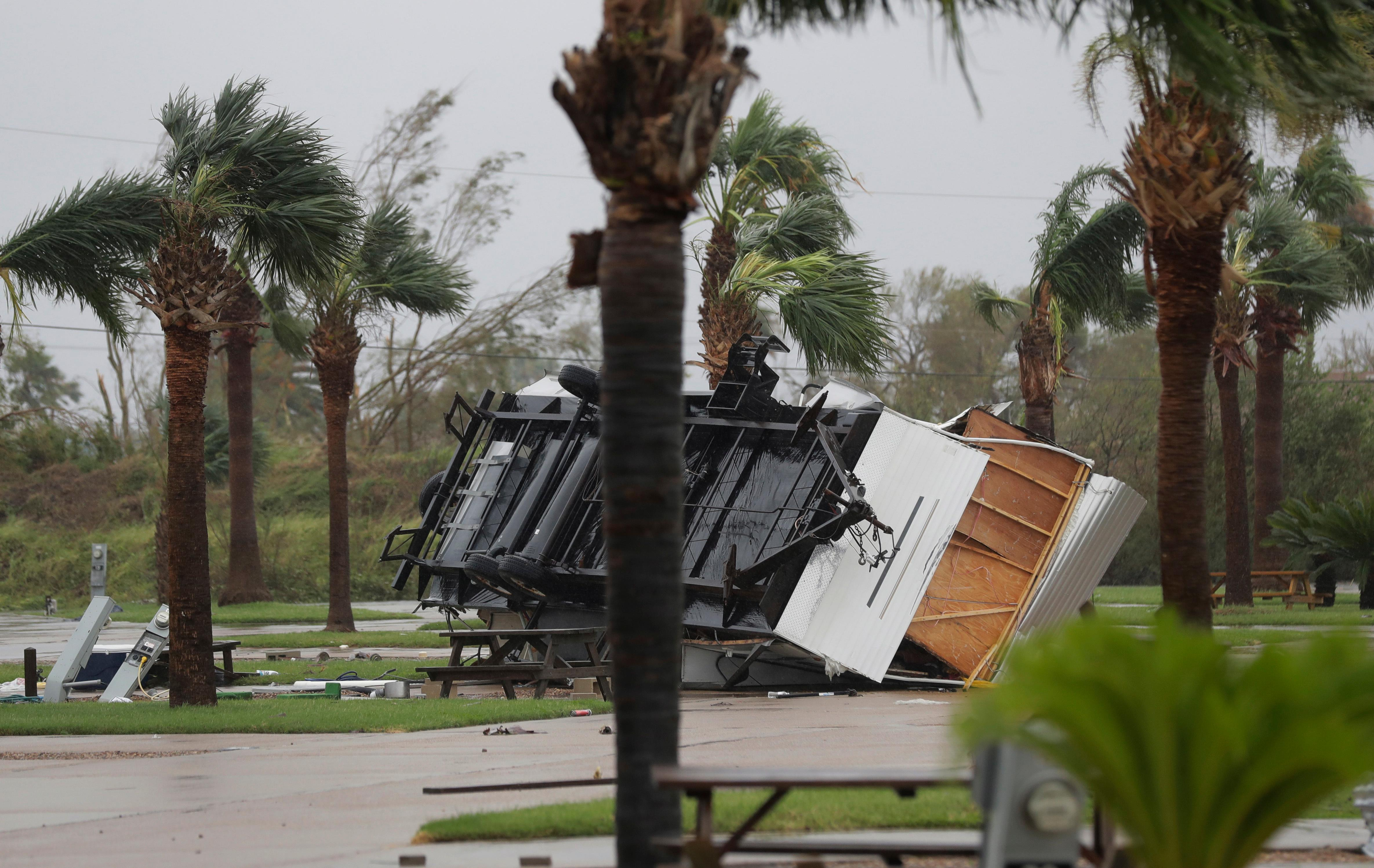 An overturned trailer sits in a park in the wake of Hurricane Harvey, Saturday, Aug. 26, 2017, in Aransas Pass, Texas.   Harvey rolled over the Texas Gulf Coast on Saturday, smashing homes and businesses and lashing the shore with wind and rain so intense that drivers were forced off the road because they could not see in front of them. (AP Photo/Eric Gay)