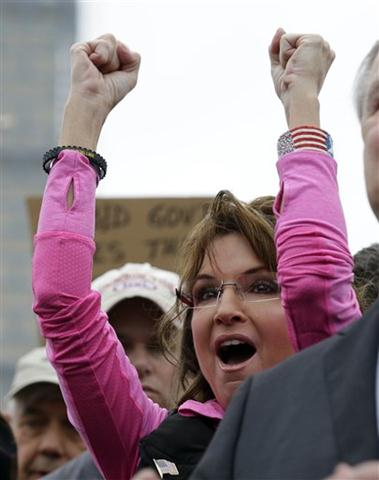 Tea Party activist and former Alaska Gov. Sarah Palin cheers during a rally at the World War II Memorial in Washington Sunday, Oct. 13, 2013.