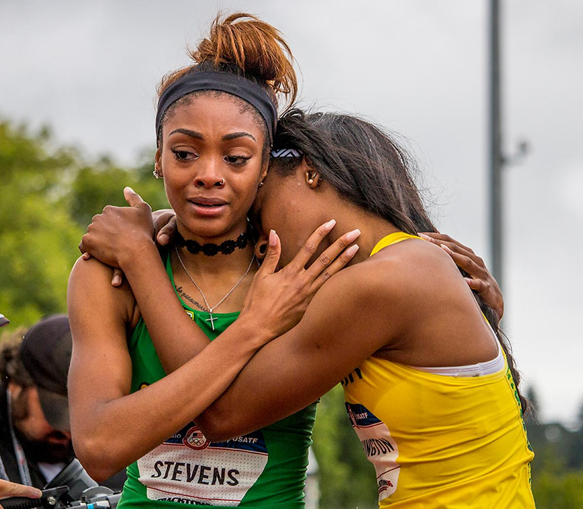 Oregon Ducks Deajah Stevens and Ariana Washington embrace eachother after the women�s 200 meter dash finals. Stevens placed second in 22.30 seconds sending her to competition in Rio. Day Ten of the U.S. Olympic Trials Track and Field concluded on Sunday at Hayward Field in Eugene, Ore. Competition lasted July 1 - July 10. Photo by Katie Pietzold