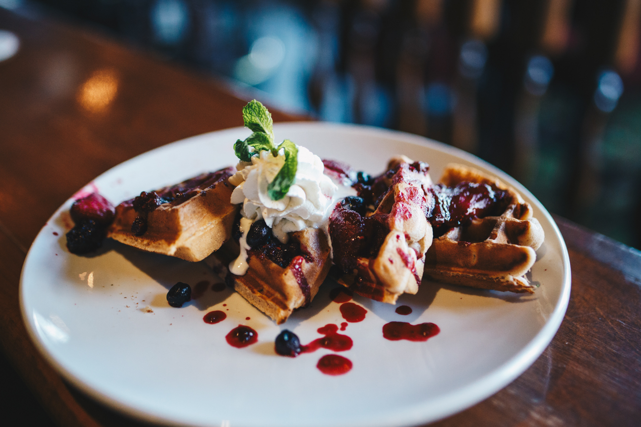 "Drunken Waffles: traditional waffle with macerated ""tipsy"" berries, brandy flambé, and Baileys whipped cream / Image: Catherine Viox // Published: 5.4.18"