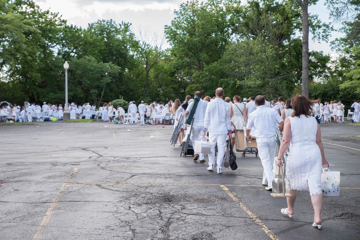 Cincinnati's Diner en Blanc took place on Saturday, June 24 at the Cincinnati Art Museum. The event, which was first established in Paris, is a secret dinner pop-up party. Guests must be dressed in white and bring their own table, chairs, and food. There were approximately 1,700 participants. / Image: Sherry Lachelle Photography // Published: 6.25.17