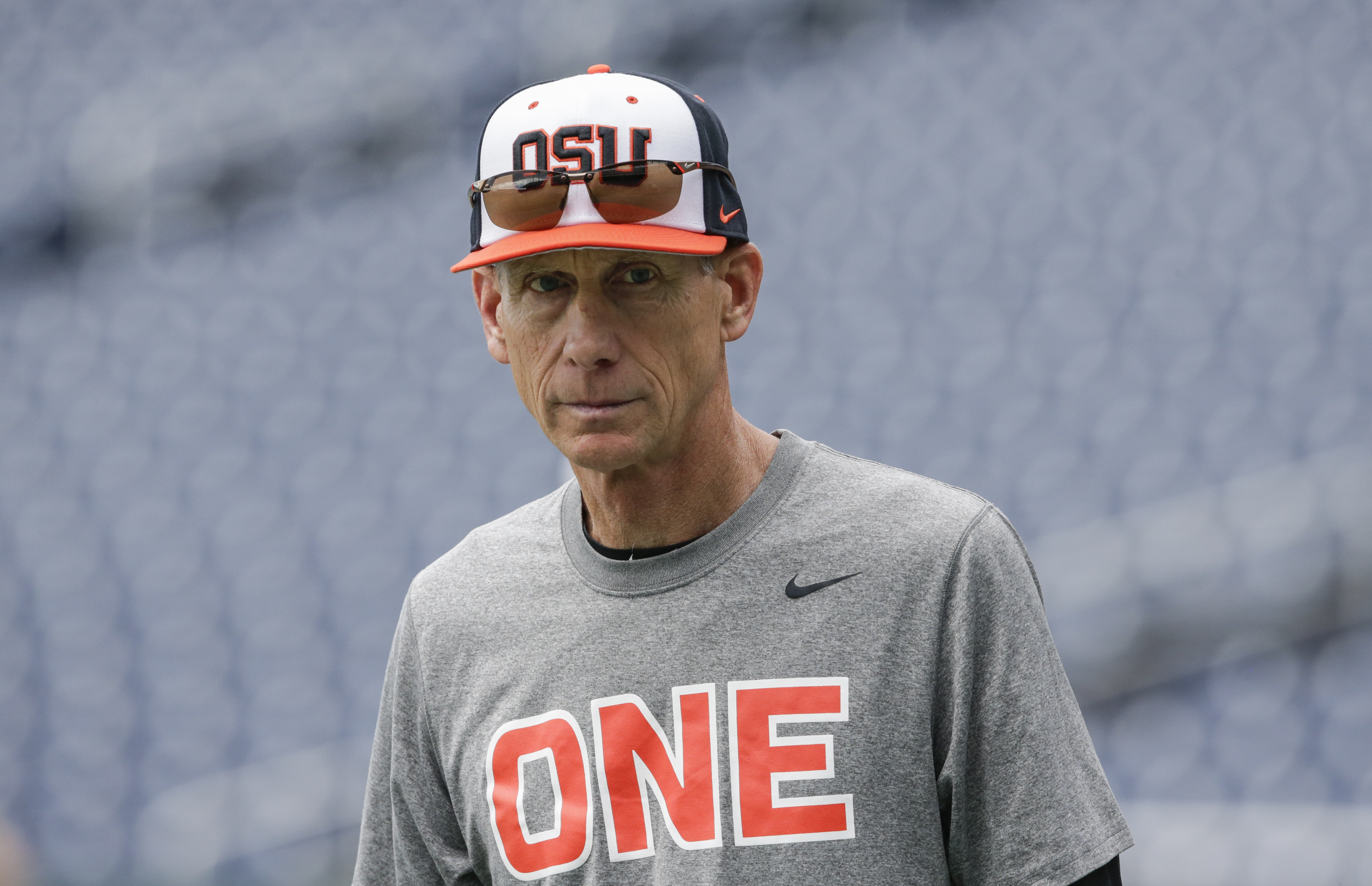 Oregon State coach Pat Casey follows team practice in Omaha, Neb., Friday, June 16, 2017. Oregon State is on the cusp of joining the company of the greatest college baseball teams of all time. At 54-4, the Beavers enter the College World Series with the fewest losses of any team since 1982. (AP Photo/Nati Harnik)