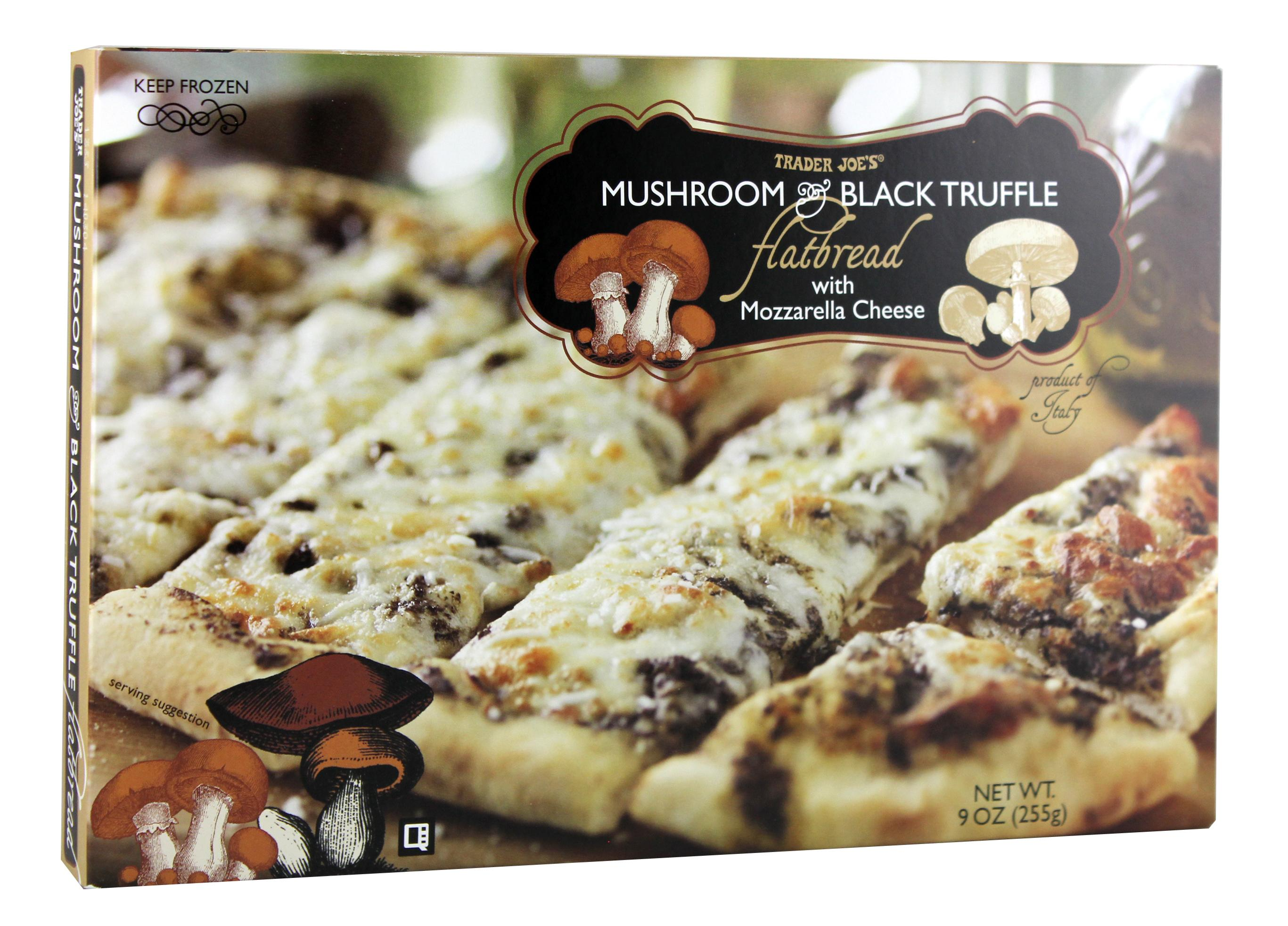 "Mushroom & Black Truffle Flatbread. Hosting a gathering? Don't want to cook? Bake up this flatbread and wow your guests.{ }On a monthly basis I rotate through three grocery stops - Costco, Walmart Pick-up, and Trader Joe's. And, you guessed it, Trader Joe's is my favorite. Do you love it too? I have classic staples there and am always finding new favorites. That's the joy things there follow the old adage ""Make new friends but keep the old"". How they smoosh so many amazing products into their few rows, I will never know, but I no doubt discover fabulous things ever time my red cart wanders through. (Image: Trader Joes)"