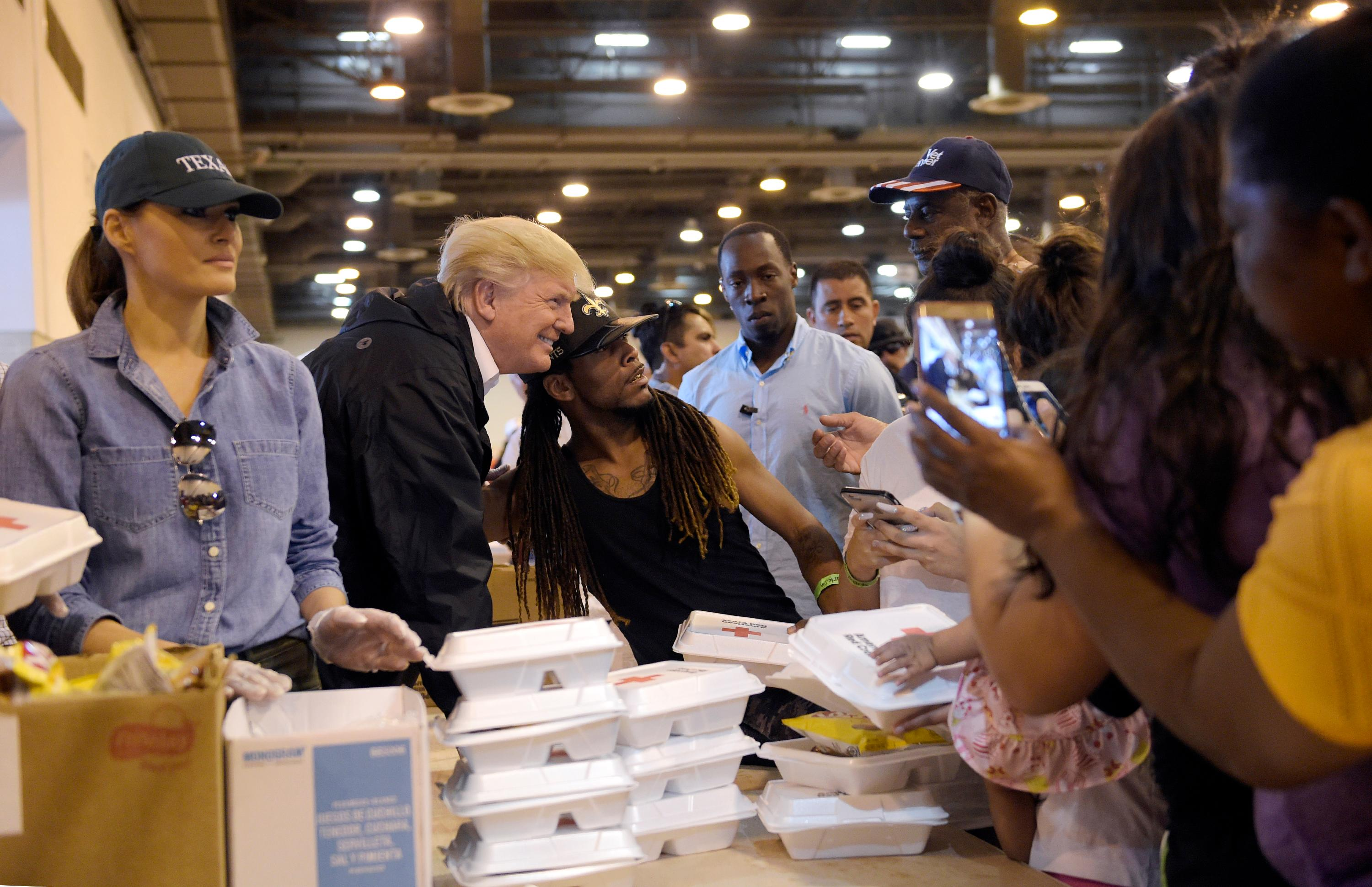 President Donald Trump and Melania Trump pass out food and meet people impacted by Hurricane Harvey during a visit to the NRG Center in Houston, Saturday, Sept. 2, 2017. It was his second trip to Texas in a week, and this time his first order of business was to meet with those affected by the record-setting rainfall and flooding. He's also set to survey some of the damage and head to Lake Charles, Louisiana, another hard-hit area.  (AP Photo/Susan Walsh)
