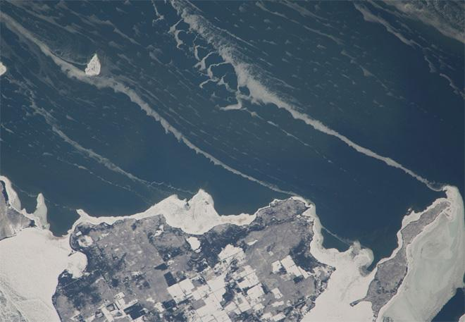 Snow-covered fields appear as geometric patterns on Washington Island, on Lake Michigan (Photo & Caption: NASA)