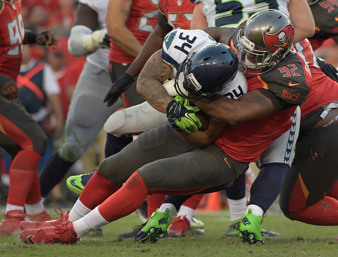 Tampa Bay Buccaneers defensive end William Gholston (92) stops Seattle Seahawks running back Thomas Rawls (34) on a run during the second quarter of an NFL football game Sunday, Nov. 27, 2016, in Tampa, Fla. (AP Photo/Phelan Ebenhack)
