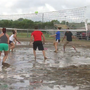 Volleyball teams play in the mud to raise money for Alzheimer's Association