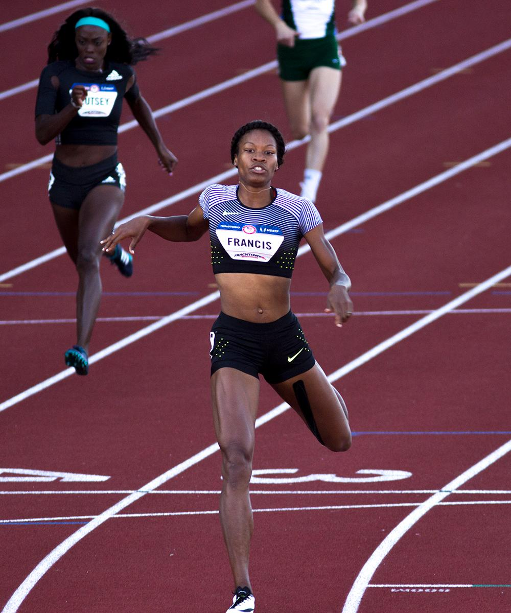 Nike�s Phyllis Francis crosses the finish line in heat 2 of the Women�s 400m dash. Francis finished in 2nd overall and qualified for the Olympics with a time of 50.81. Day one of the U.S. Olympic Trials began on Friday at Hayward Field in Eugene, Ore. And will continue through July 10. (Photo by Amanda Butt)