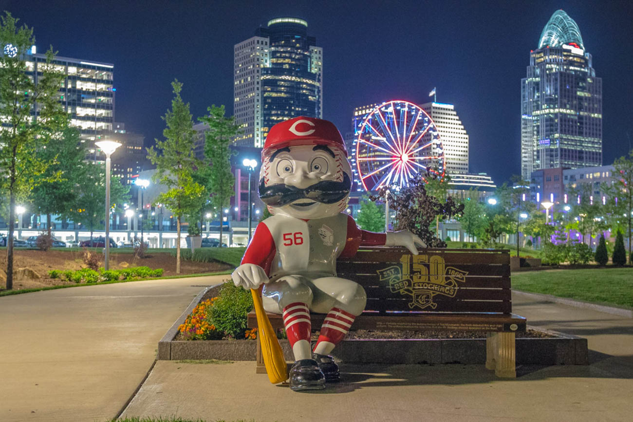 To celebrate the Reds' 150th Anniversary, 24 benches featuring Mr. Redlegs sculptures have been added to various spots around the area, as well as out of town locations including Dayton, Loveland, and Louisville, for the perfect Reds photo op. The mascot sports different uniforms from throughout the team's history at each of the benches. The Reds have been wearing these same throwback uniforms during their 2019 season. / Location:{ }Castelinni Esplanade / Uniform: 1956 / Image courtesy of Instagram user @jamie_demasi    // Published: 5.14.19