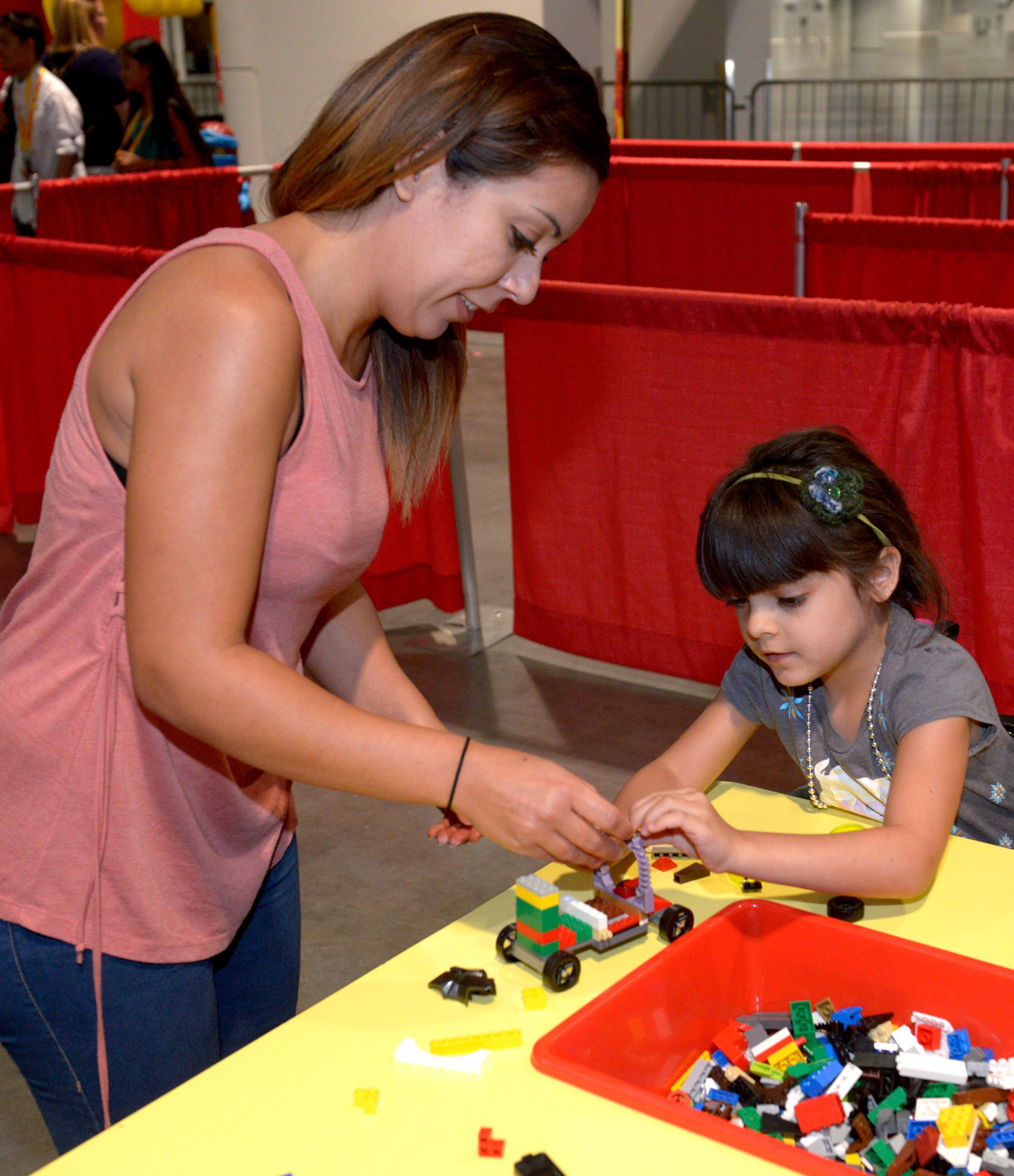Mom helps put the finishing touches on their Lego car before they head to the Lego speedway during the Brick Fest Live Lego Fan Experience at the Las Vegas Convention Center, September 9, 2017. [Glenn Pinkerton/Las Vegas News Bureau]