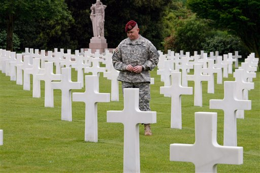 Craig Jeffery, 45, of 173rd Airborne Brigad, walks among the markers in the Normandy American Cemetery and Memorial, in Colleville sur Mer, France.