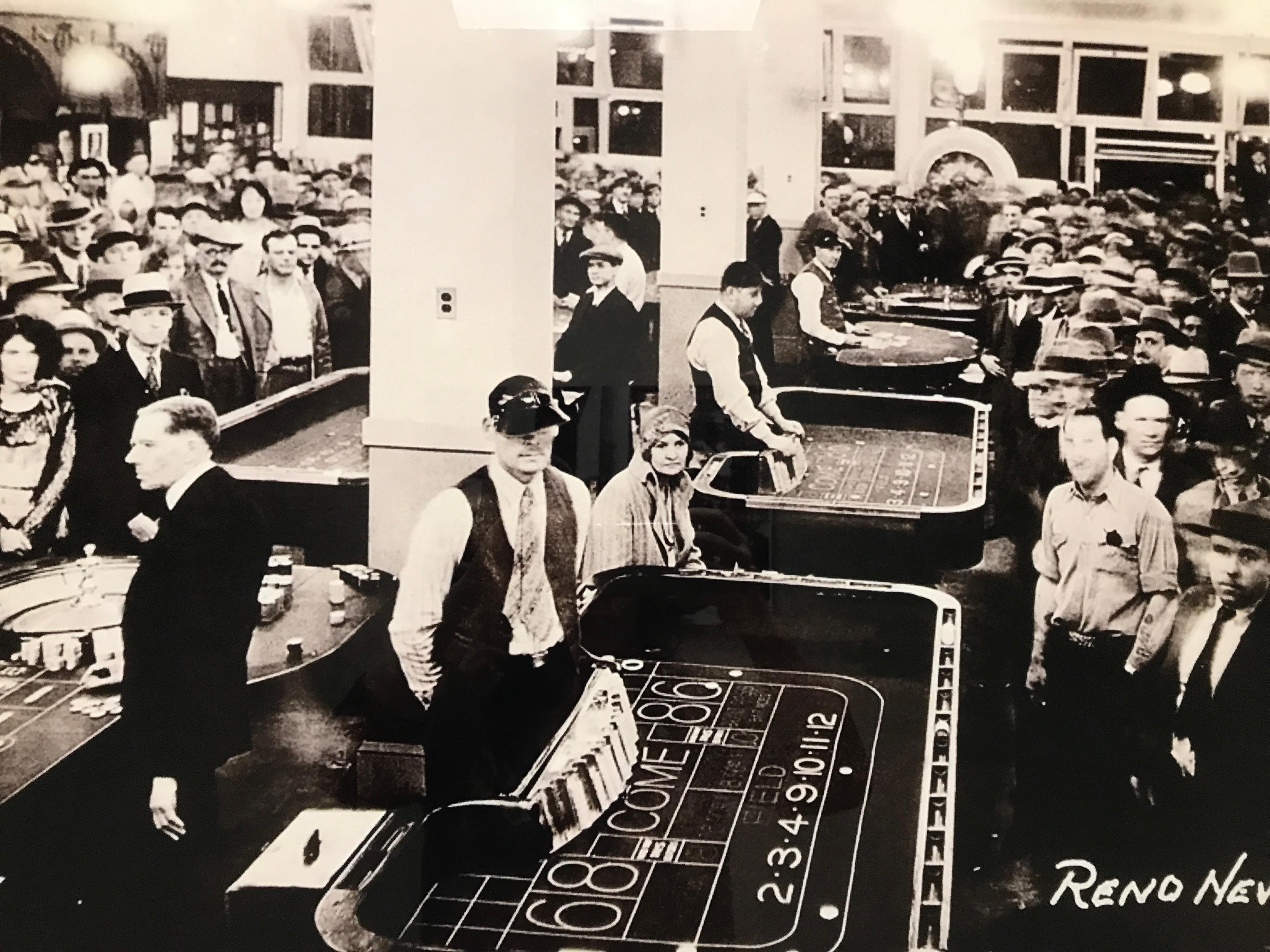 The bank Club was a popular gambling hall. This photo documents the grand opening of the club's newly remodeled, ground floor casino a few weeks after the legalization of open gambling in Nevada. (Photo courtesy: Reno Divorce Society)