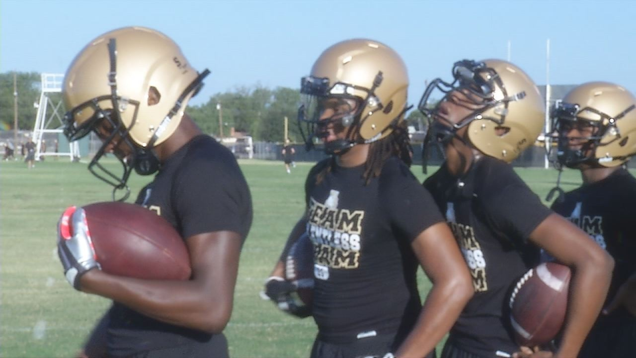 Abilene High running backs participate in first practice.