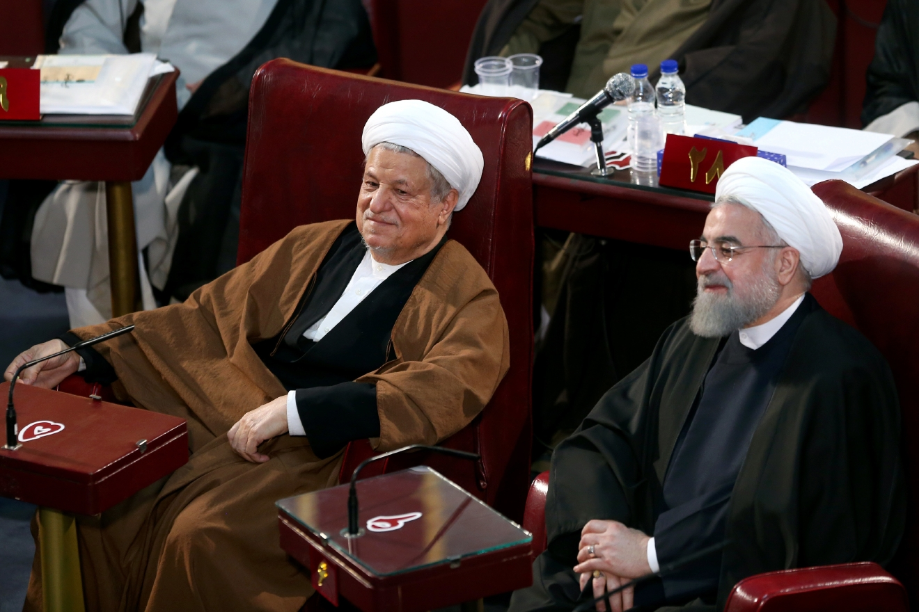 FILE -- In this March 8, 2016 file photo, Iranian President Hassan Rouhani, right, and former President Akbar Hashemi Rafsanjani, left, who are members of the Assembly of Experts, attend an assembly in Tehran, Iran. Iranian state media said Sunday, Jan. 8, 2017 that Rafsanjani has died at age 82 after having been hospitalized because of a heart condition. Rafsanjani, who served as president from 1989 to 1997, was a leading politician who often played kingmaker in the country's turbulent politics. He supported President Hassan Rouhani. (AP Photo/Ebrahim Noroozi, File)