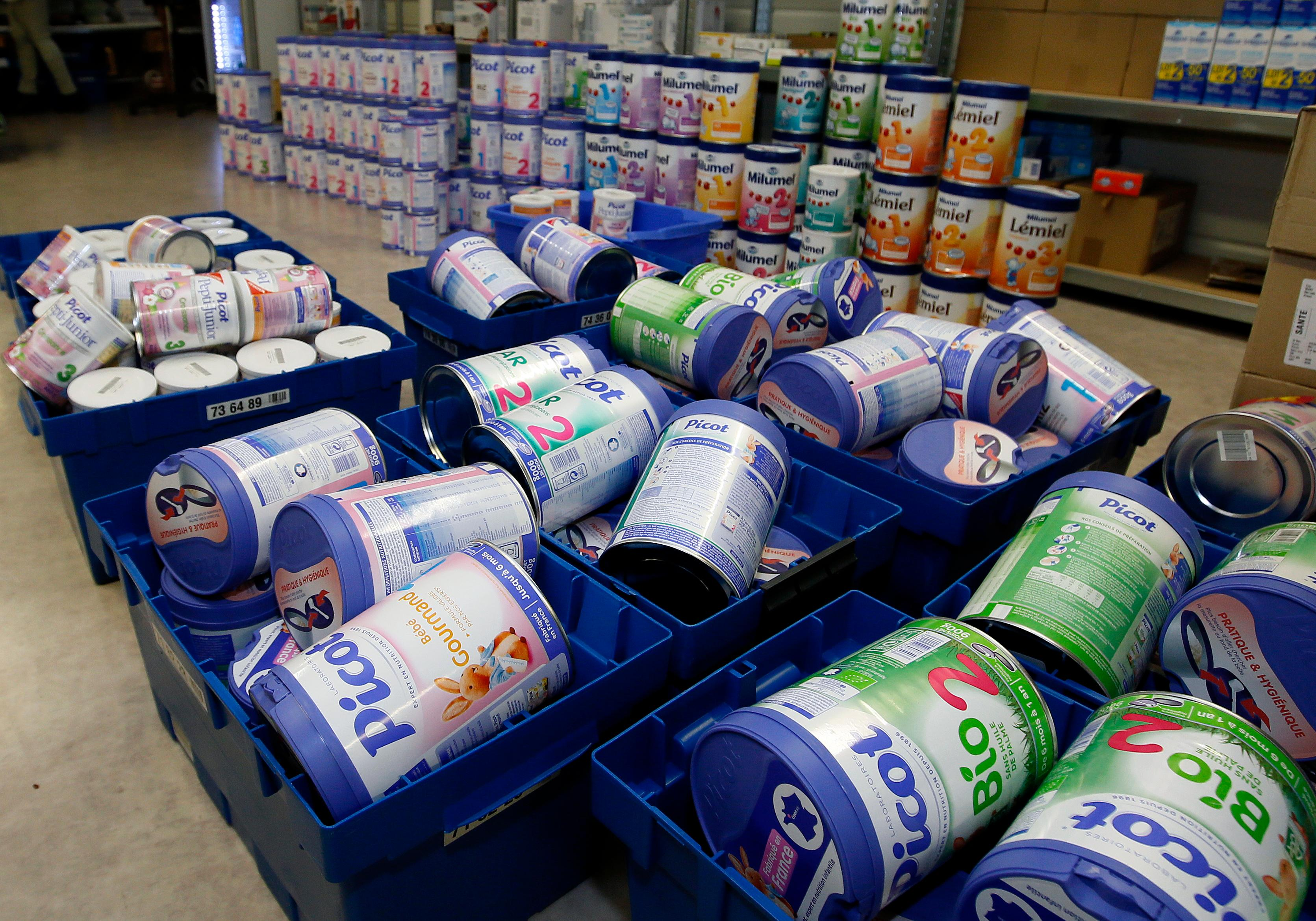 Removed baby milk boxes are pictured in a drugstore in Anglet, southwestern France, Monday, Dec.11, 2017. Baby milk maker Lactalis and French authorities have ordered a global recall of millions of products over fears of salmonella bacteria contamination. The French company, one of the largest dairy groups in the world, said it has been warned by health authorities in France that 26 infants have become sick since Dec. 1. (AP Photo/Bob Edme)