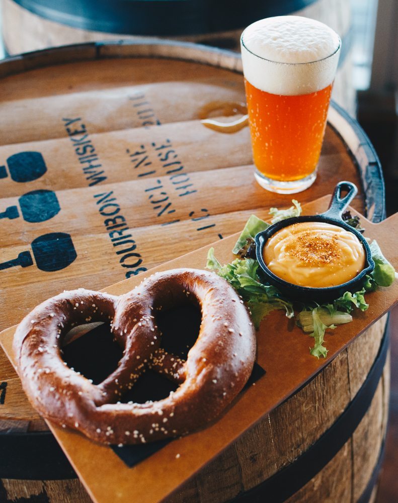 Pretzel and beer cheese with a pint of Happy Amber / Image: Catherine Viox // Published: 10.17.18