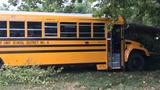 Champaign school bus crashes into house