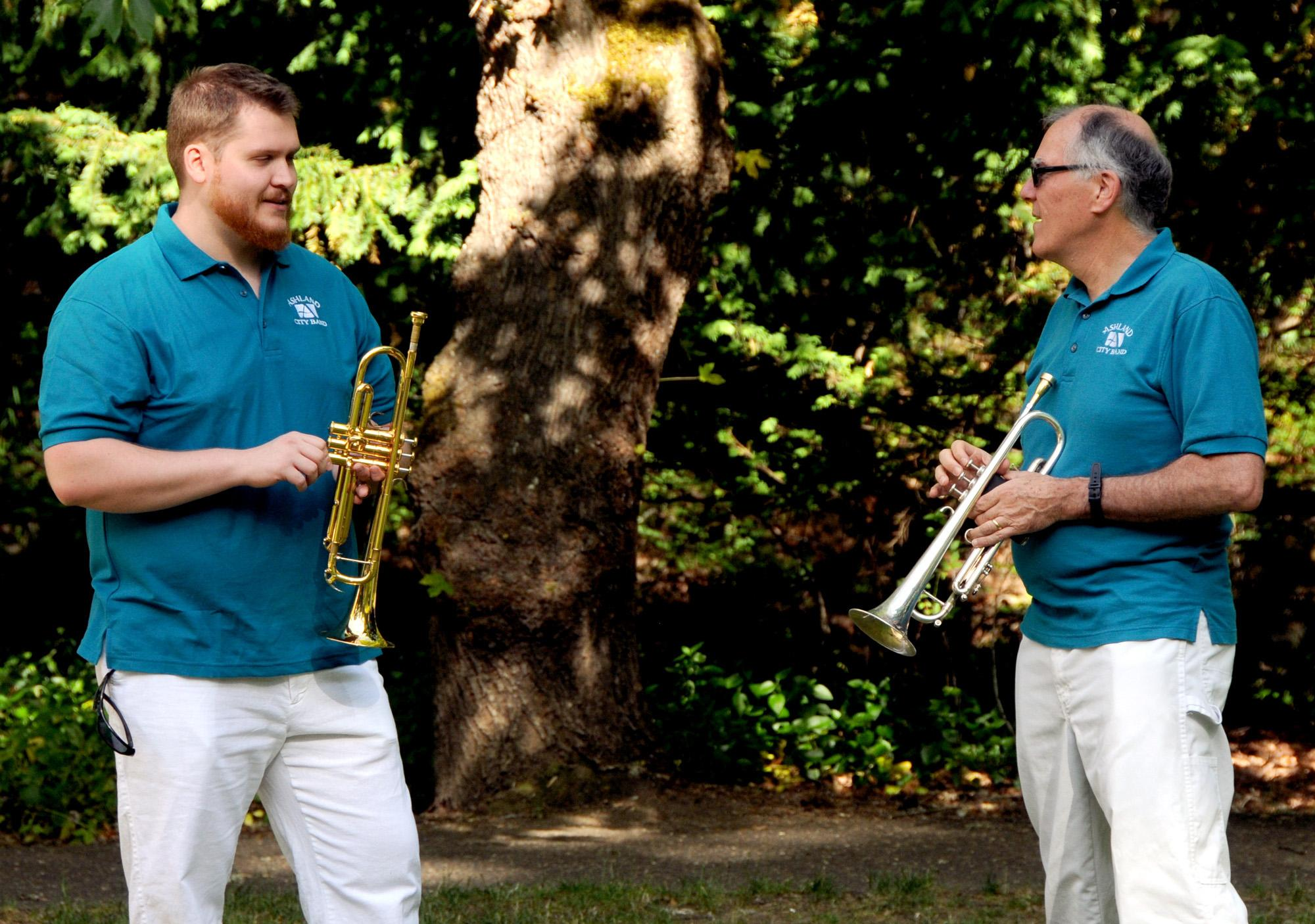 Trumpeters Kirk Albachten (left) and Bruce Dresser talk shop before the concert. (Photo by Jim Flint)