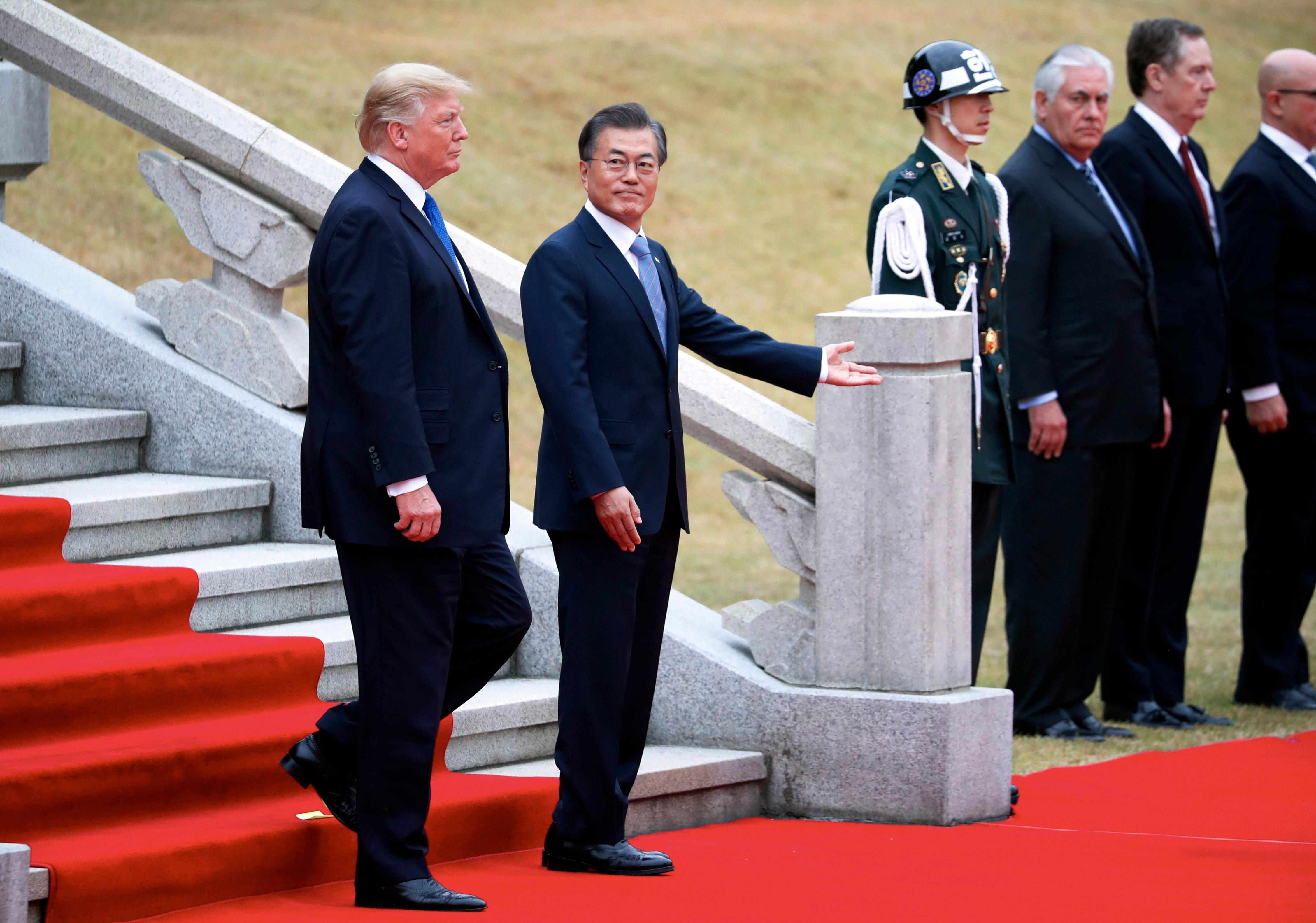 U.S. President Donald Trump, left, and South Korea's President Moon Jae-in attend a welcoming ceremony at the Presidential Blue House in Seoul Tuesday, Nov. 7, 2017. (Kim Hong-ji/Pool Photo via AP)