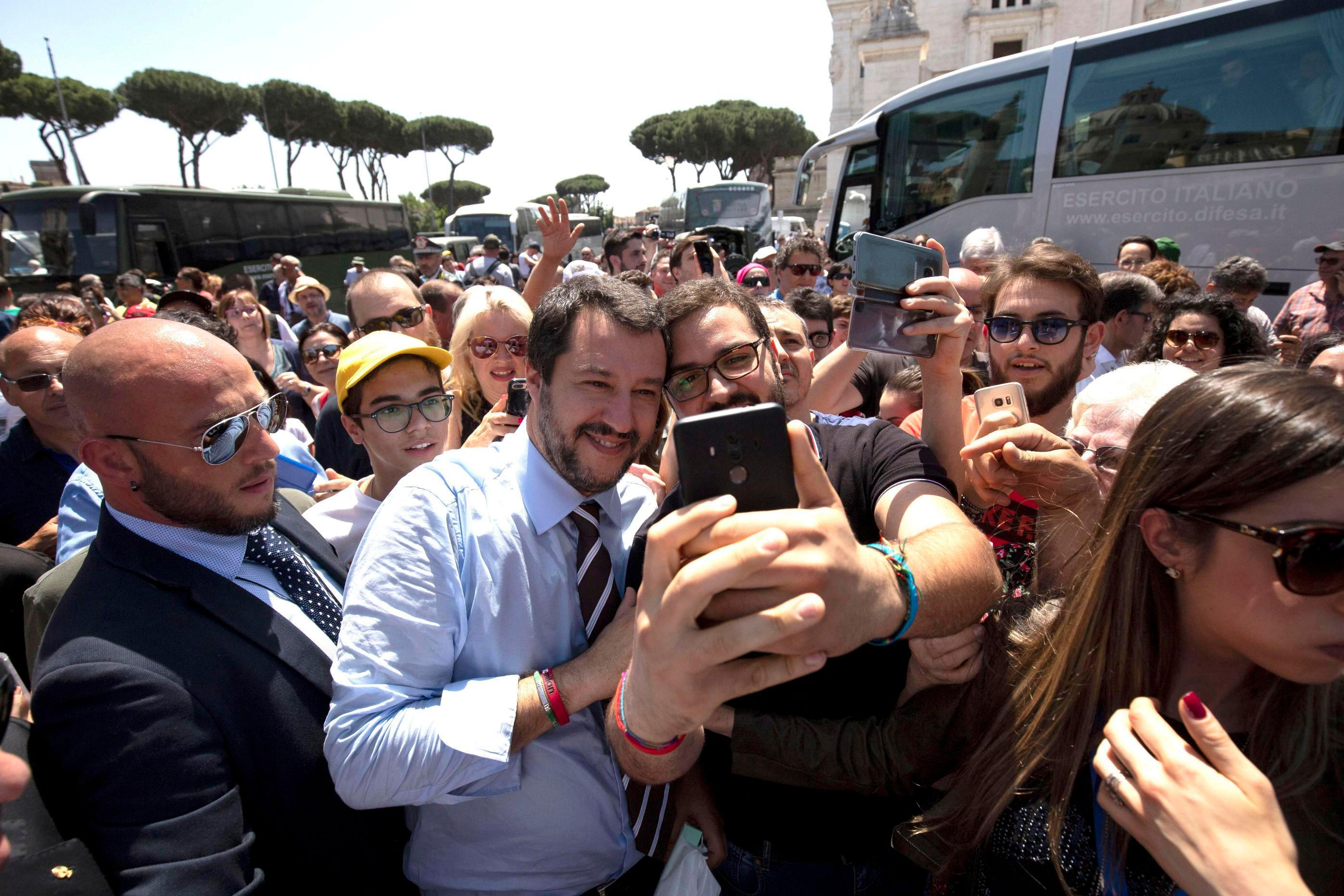 Leader of the League party and Italian Interior Minister, Matteo Salvini, poses for a photo as he walks through the crowd on the occasion of celebrations for Italy's Republic Day, in Rome Saturday, June 2, 2018. (Claudio Peri/ANSA via AP)
