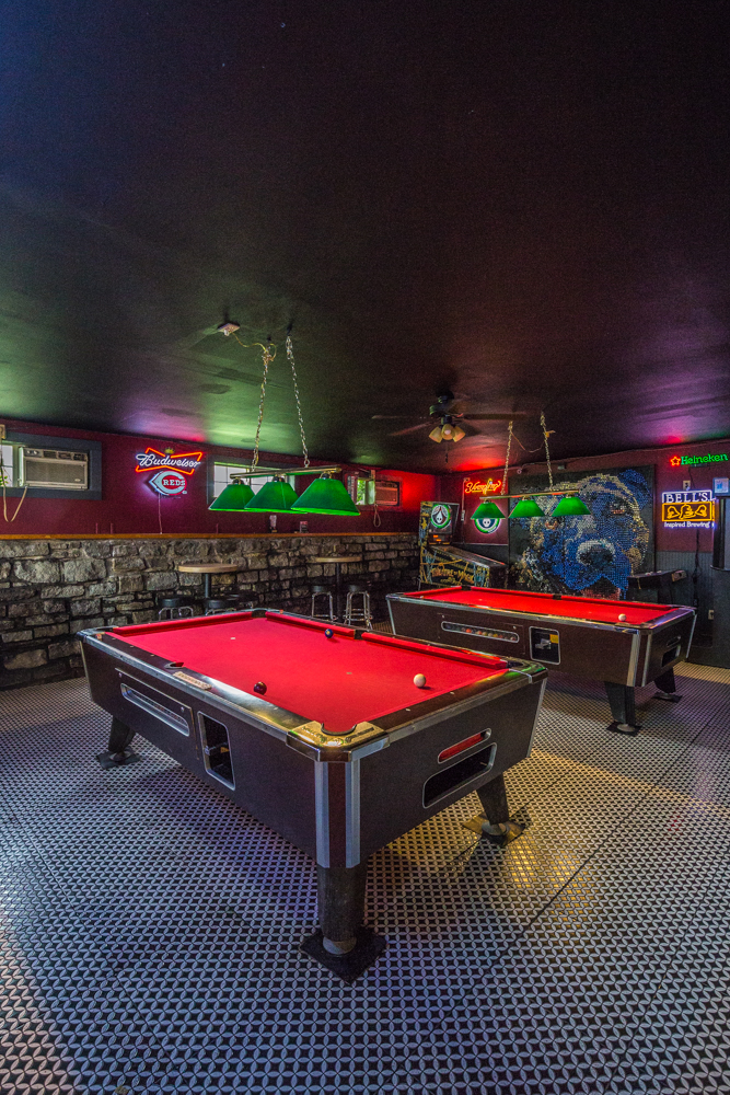 The Montgomery dive bar has dart boards, arcade games, three pool tables, and a charming patio space. Check in for weekly drink specials and live music performances. / Image: Catherine Viox // Published: 5.20.19