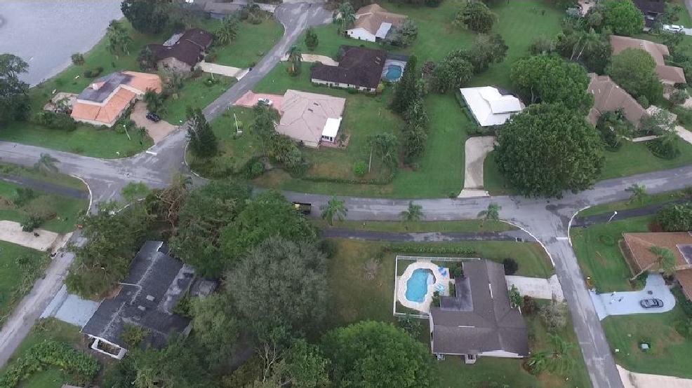 Crews dispatch drone to assess damage in palm beach for Garage door repair palm beach gardens