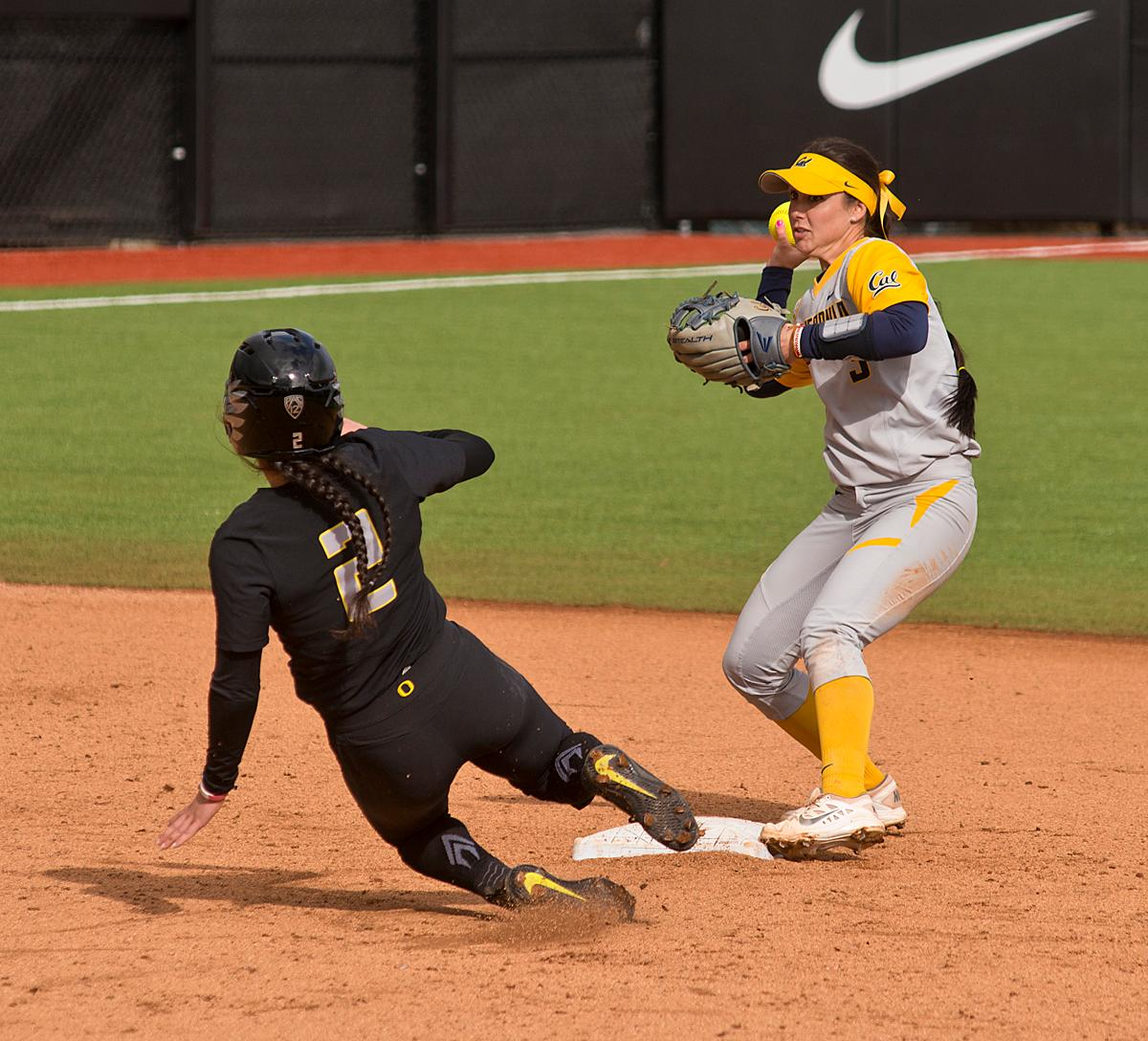 California Golden Bears second base player Kylie Reed (#3) turns a double play after getting Oregon Ducks Danica Mercado (#2) out. The Ducks defeated the Golden Bears 2-1 in the second game of a three game series. Photo By Dan Morrison, Oregon News Lab