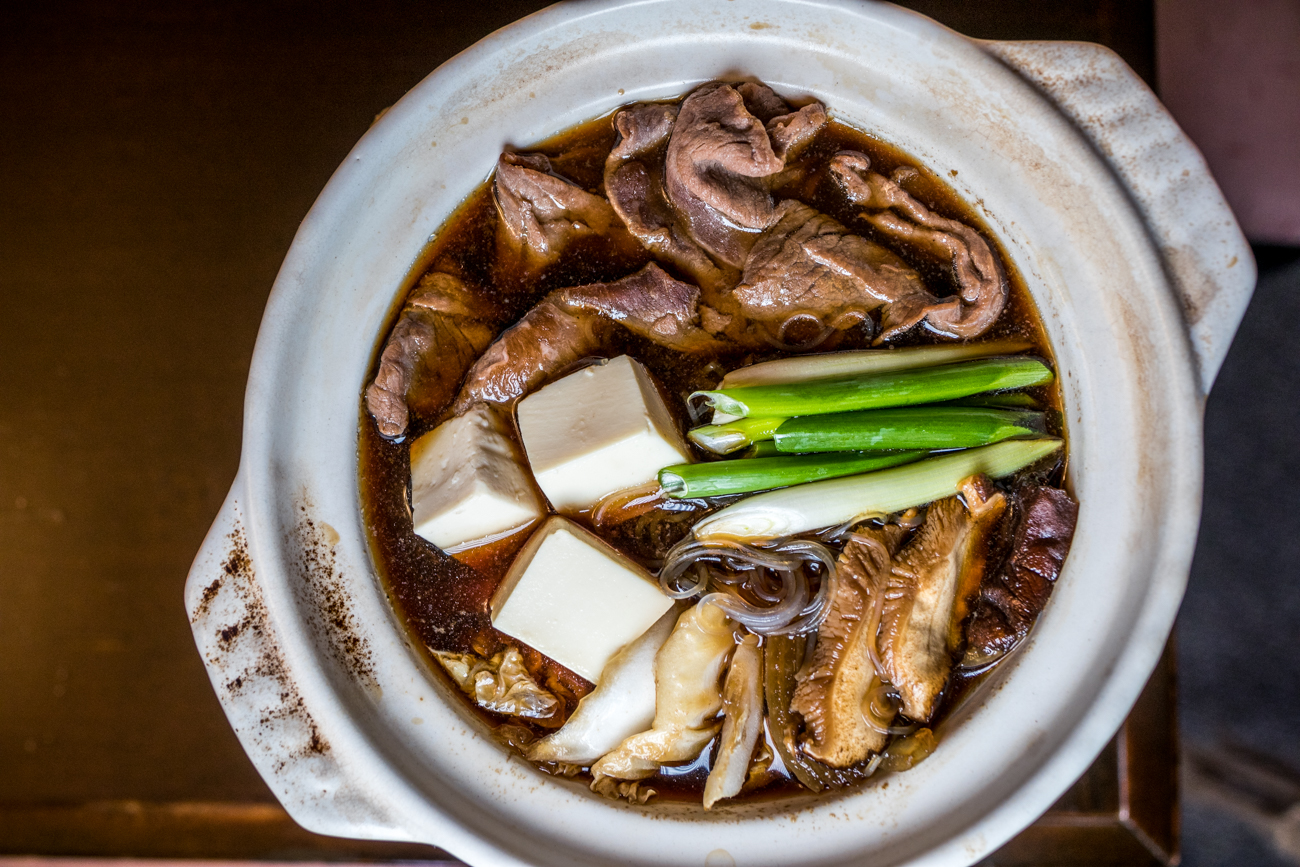 Sukiyaki: thinly sliced beef and vegetables simmered with a soy-based sauce in a clay pot / Image: Catherine Viox // Published: 1.3.21