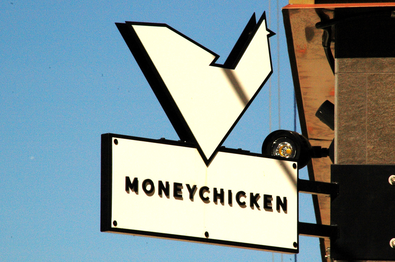 The restaurant's name came from a cartoon chicken initially considered for branding. The anthropomorphized bird, often wearing a dollar-sign gold necklace, was designed by Blake Lipper, a co-owner of Midwestern Press. Lipper's final design went in a different direction, but the resulting name remains. / Image: Sean Peters // Published: 12.7.18