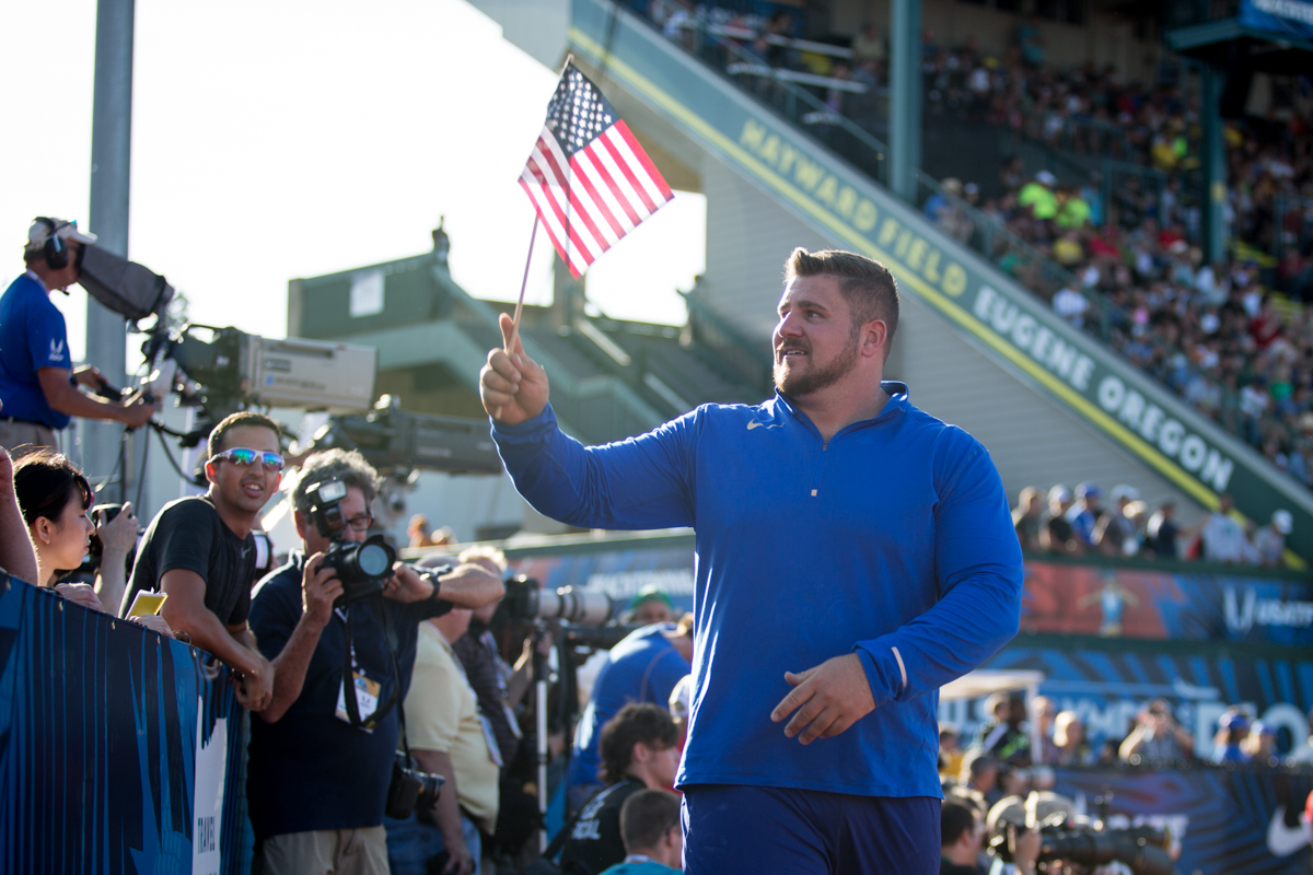 Nike�s Joe Kovacs waves the American flag after taking second place in the men�s shot put. Photo by Dillon Vibes