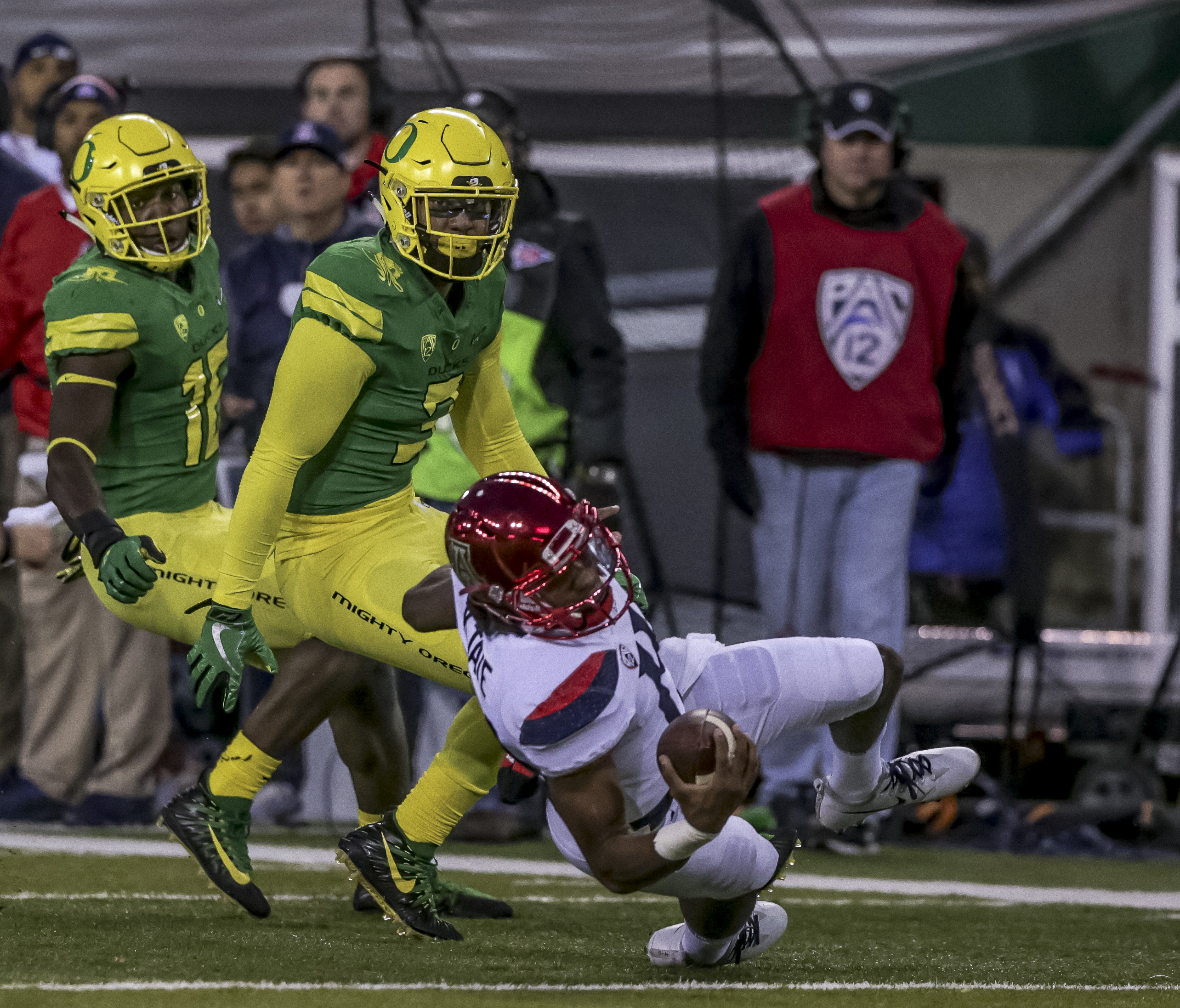 Arizona quarterback Khalil Tate (#14) is knocked down by the Oregon defense. The Oregon Ducks lead the Arizona Wildcats 28 to 21 at the end of the first half at Autzen Stadium on Saturday, November 18, 2017. Photo by Ben Lonergan, Oregon News Lab