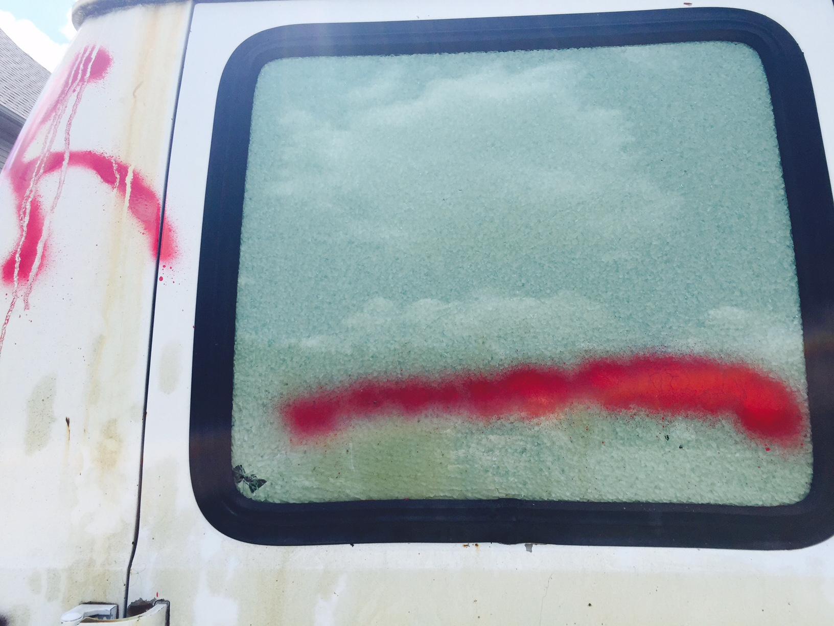Words and images spray painted on family's van