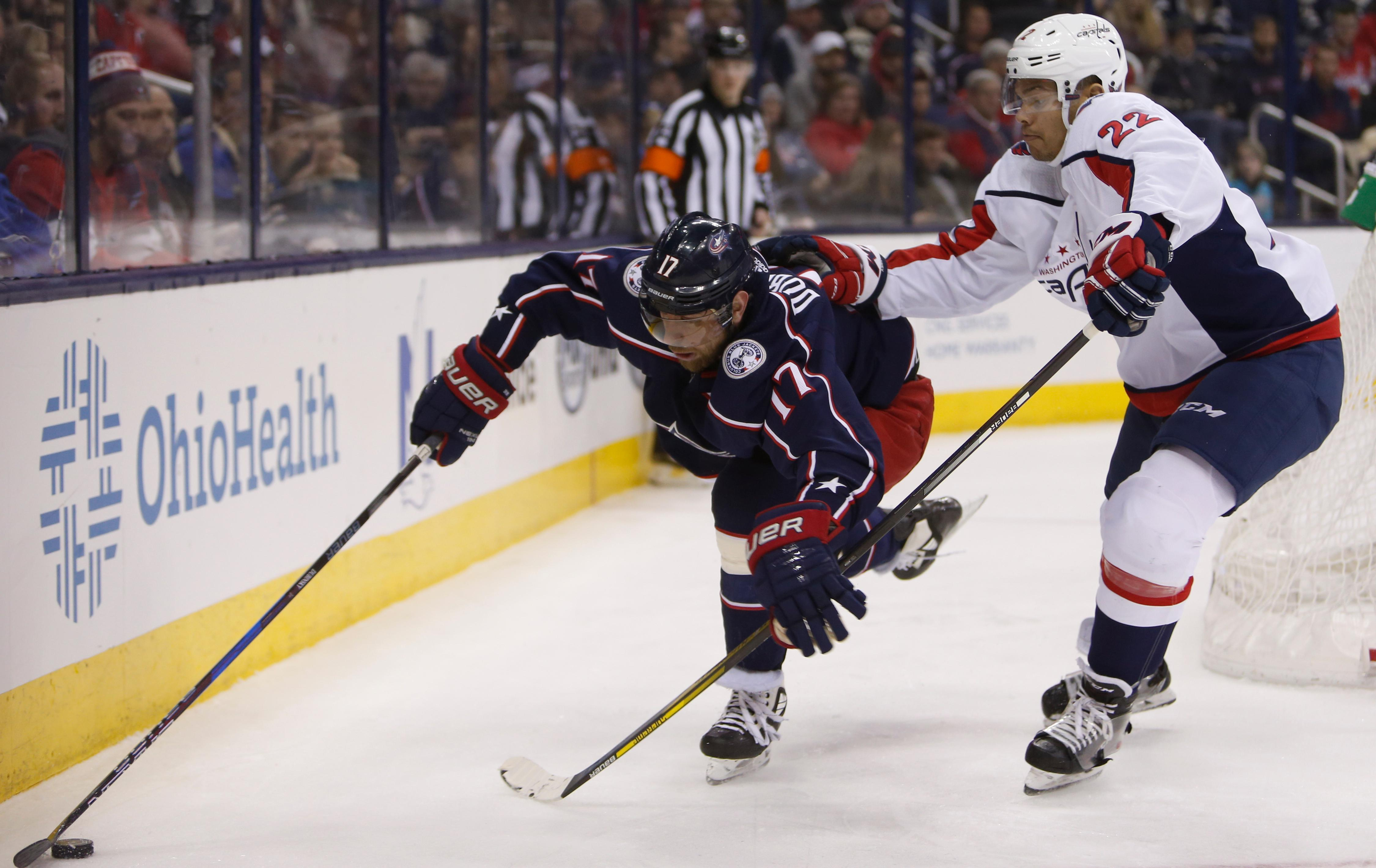 Columbus Blue Jackets' Brandon Dubinsky, left, tries to control the puck as Washington Capitals' Madison Bowey defends during the second period of an NHL hockey game Tuesday, Feb. 6, 2018, in Columbus, Ohio. (AP Photo/Jay LaPrete)