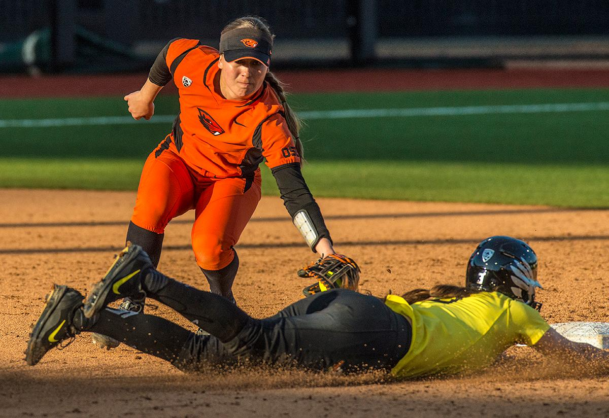 Oregon Ducks Nikki Adria (#3) slides into second base. The Oregon Ducks defeated the Oregon State Beavers 8-0 in game one of the three-game Civil War series on Friday night at Jane Sanders Stadium. The game was 0-0 until Gwen Svekis (#21) hit a solo home run in the fourth inning. Mia Camuso hit a grand slam in the fifth inning, ending the game for the Ducks by mercy rule. With tonight's victory, the Ducks are 39-6 and 12-6 in Pac-12 play. Photo by Rhianna Gelhart, Oregon News Lab