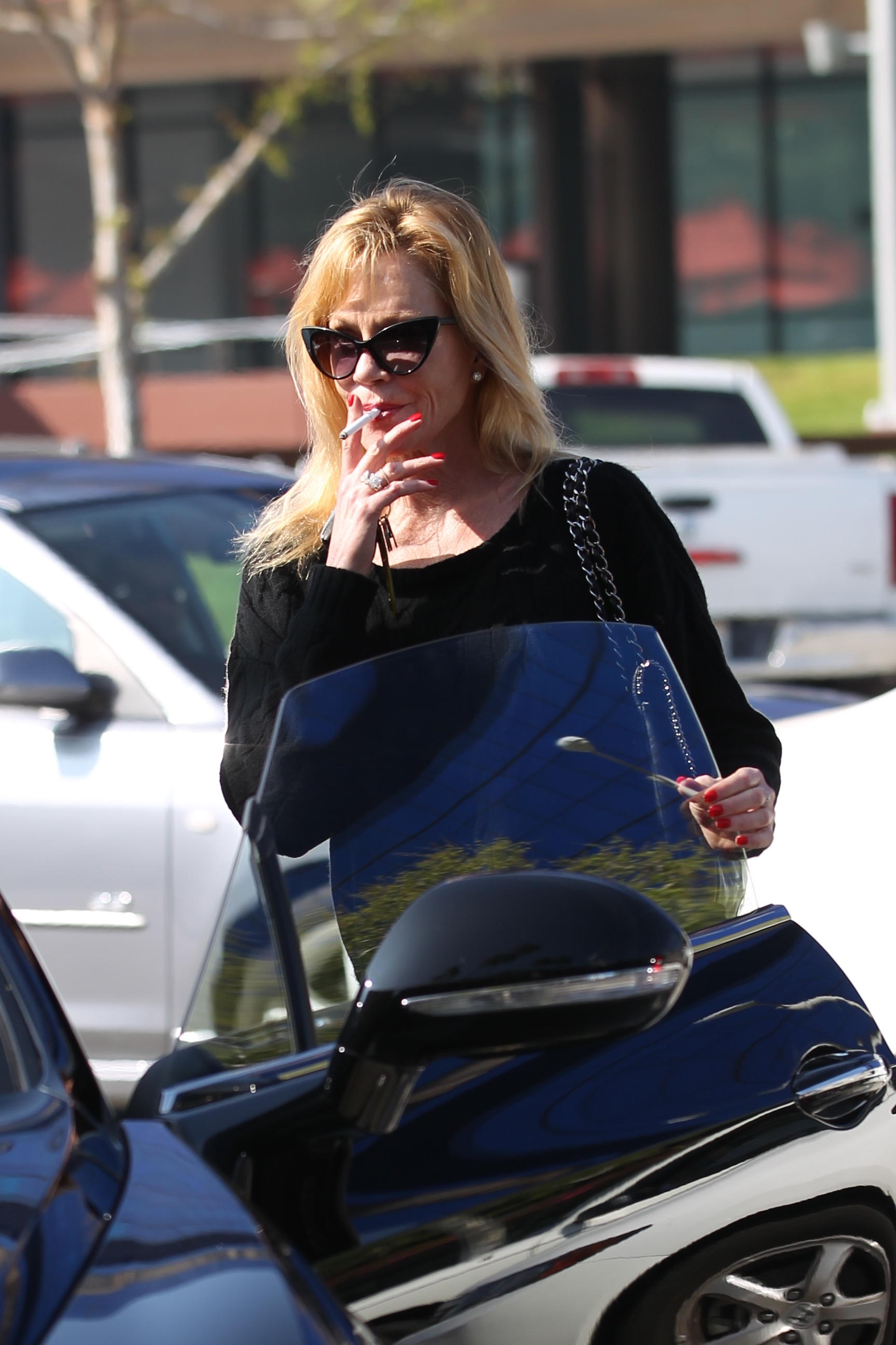 Melanie Griffith leaving Zinque cafe on Melrose Avenue                                    Featuring: Melanie Griffith                  Where: Los Angeles, California, United States                  When: 19 Feb 2015                  Credit: Owen Beiny/WENN.com