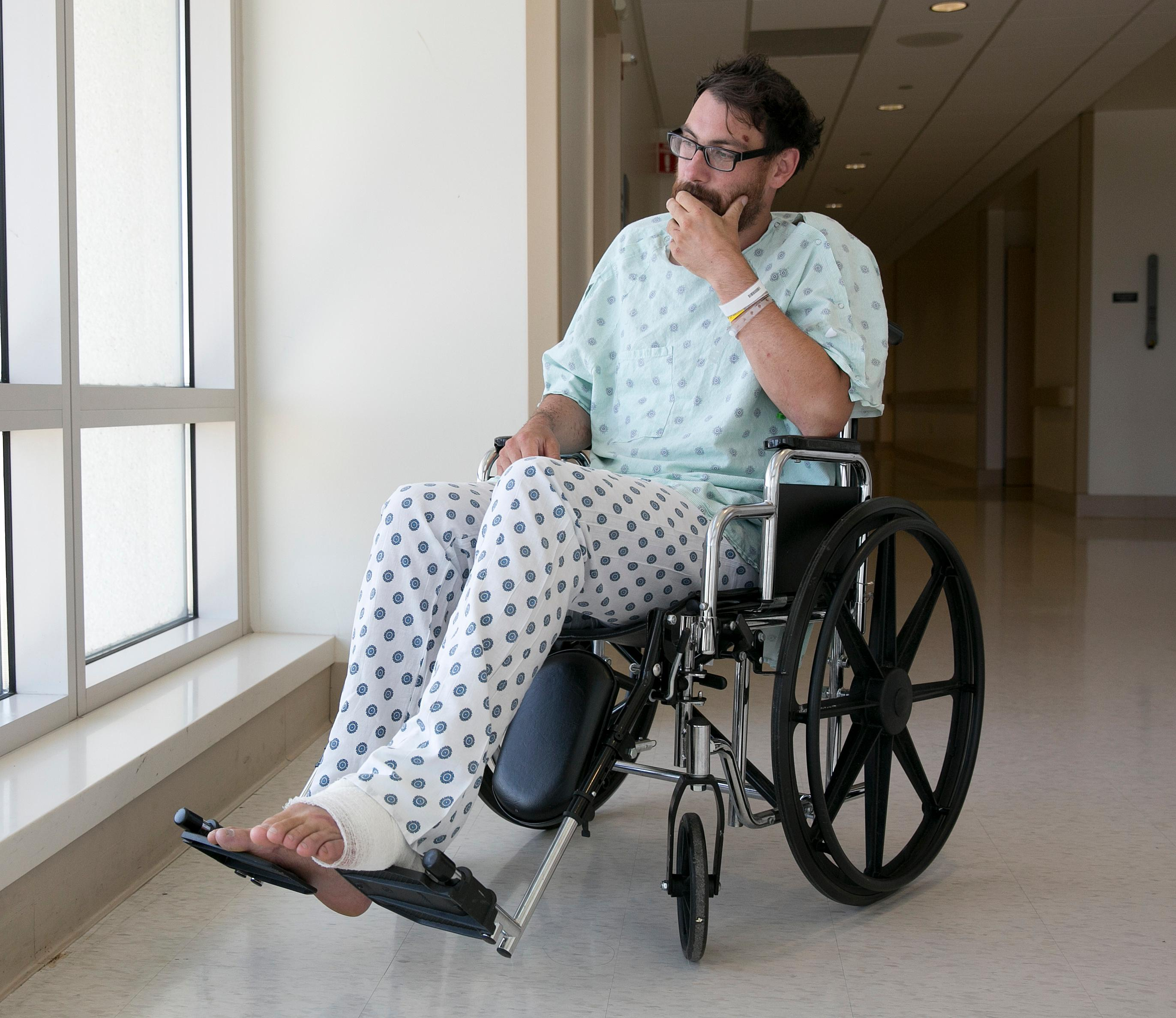 Mathias Steinhuber, of Innsbruck, Austria, who survived being struck by a lighting bolt, pauses while discussing the near-fatal event, Thursday, Aug. 24, 2017, in Sacramento, Calif. (AP Photo/Rich Pedroncelli)