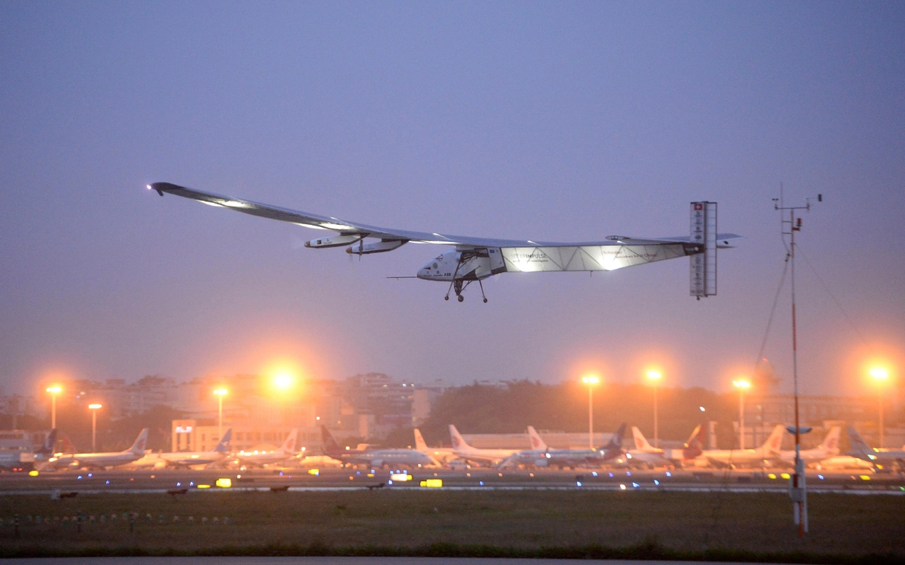 FILE - In this April 21, 2015 file photo,a  solar-powered plane takes off from Jiangbei International Airport in southwest China's Chongqing Municipality.  The solar-powered airplane landed in California on Saturday, April 23, 2016,  completing a risky, three-day flight across the Pacific Ocean as part of its journey around the world. (Chinatopix via AP, File) CHINA OUT