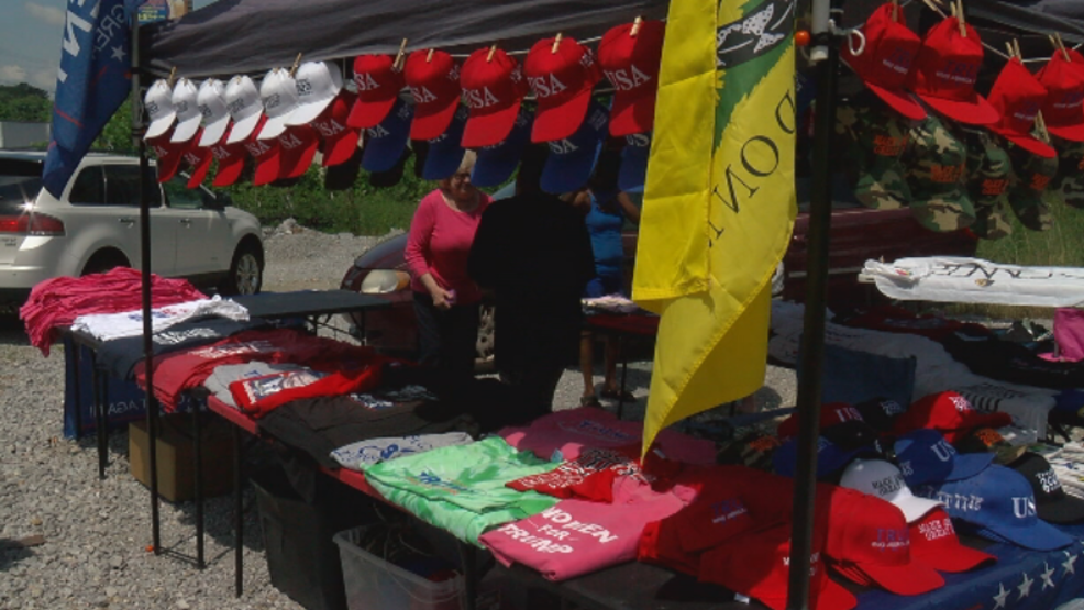 Pop-up tents are appearing on the streets of Chattanooga. Vendors are selling merchandise from the side of the road. (Image WTVC) & Pop-up tents across Chattanooga; are they allowed to be there? | WTVC