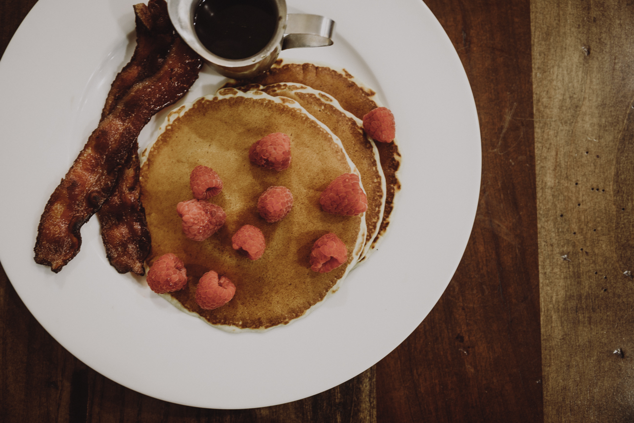 Three Stacks: pancakes topped with your choice of fruit and served with bacon or sausage / Image: Brianna Long // Published: 9.12.18